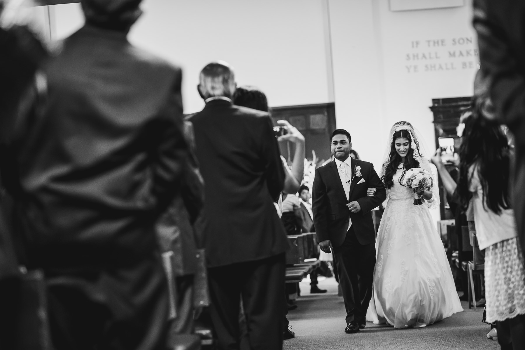 Bride and Groom exit at Christian Wedding Photography Mayfair