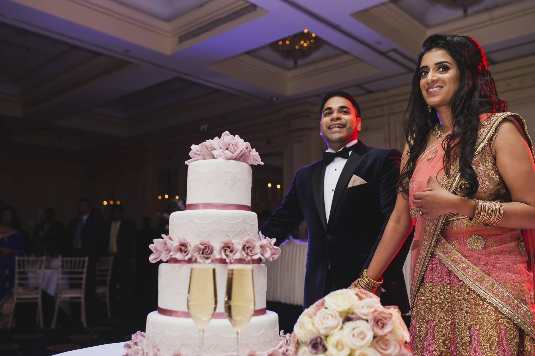 Cutting the cake at Millennium Mayfair Hotel Wedding Photography