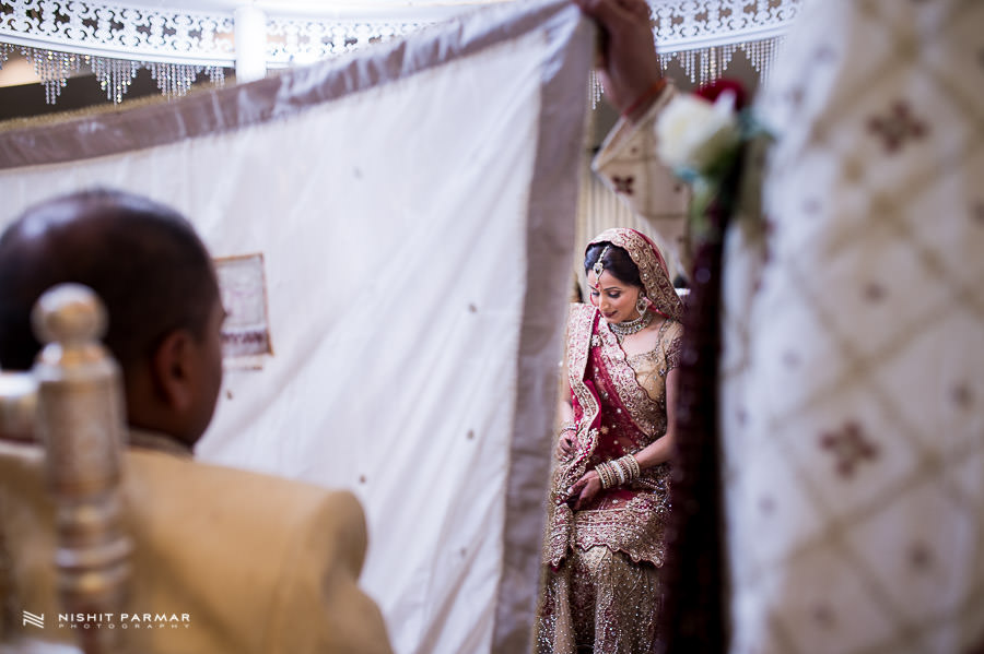 Asian Wedding Bride Groom behind curtain