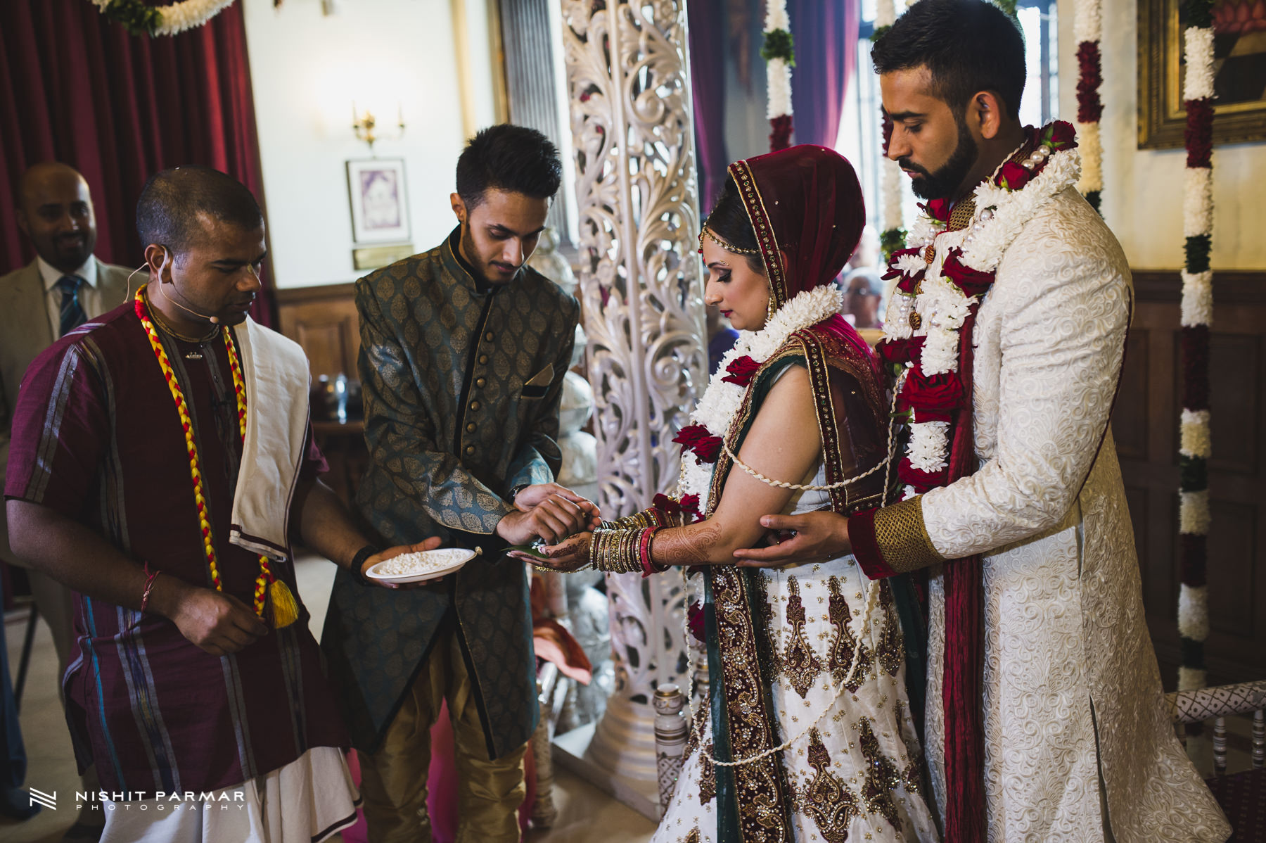 Brother blessing bride and groom