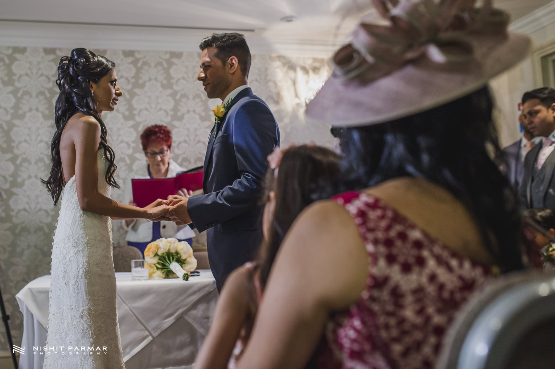 Civil Wedding Laura Ashley Manor Elstree London Wedding Photographer - bride and groom exchanging vows