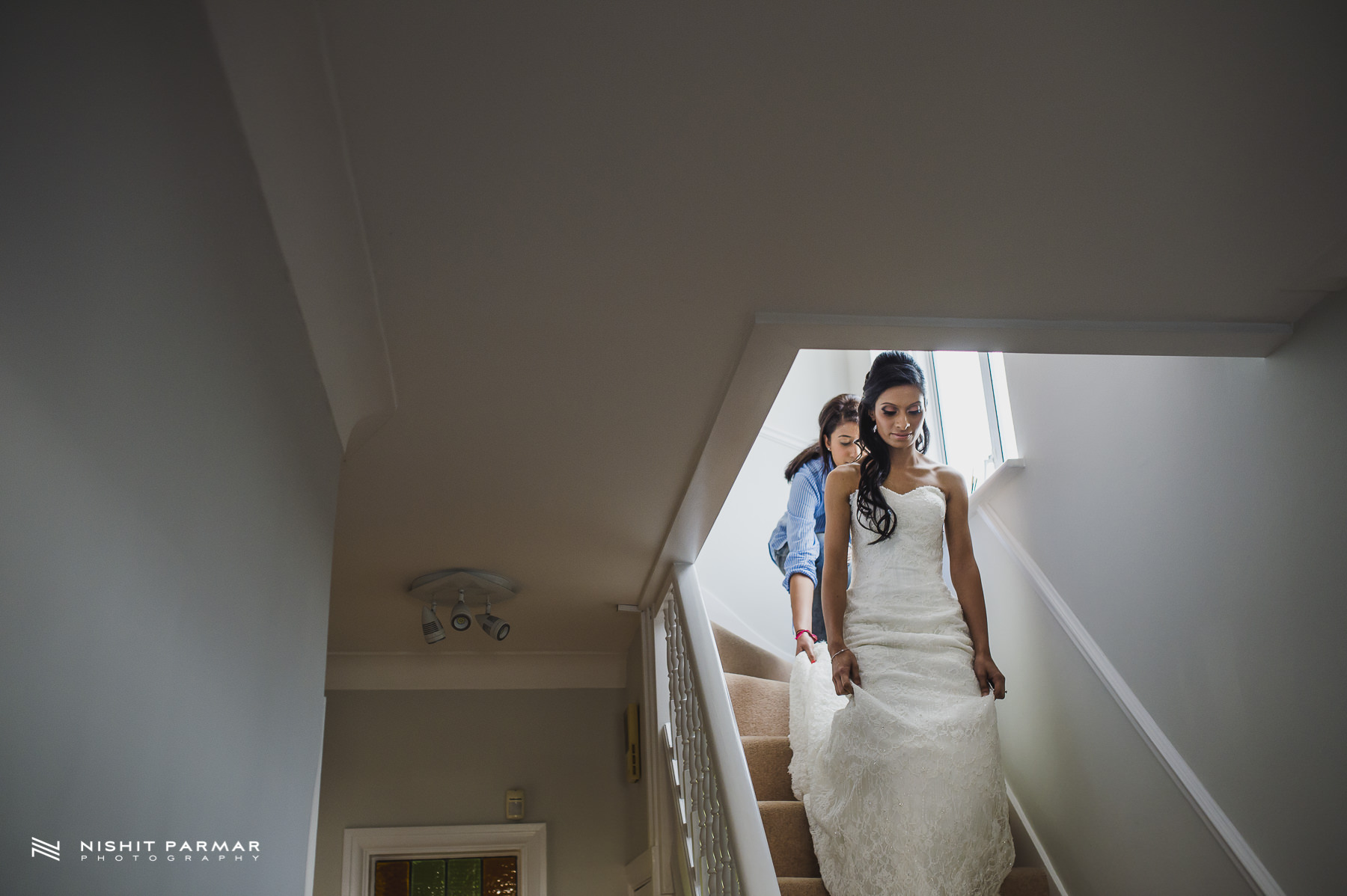 Civil Wedding Laura Ashley Manor Elstree London Wedding Photographer - Bride coming down stairs in white dress