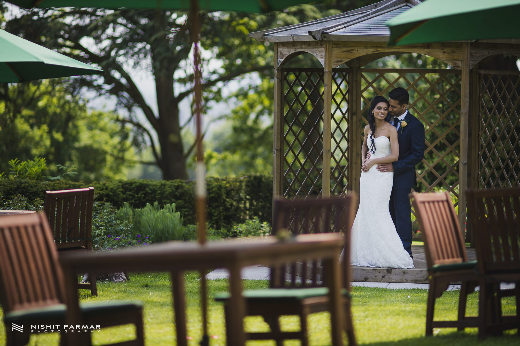 Civil Wedding Laura Ashley Manor Elstree London Wedding Photographer - bride and groom portrait in landscaped garden veranda
