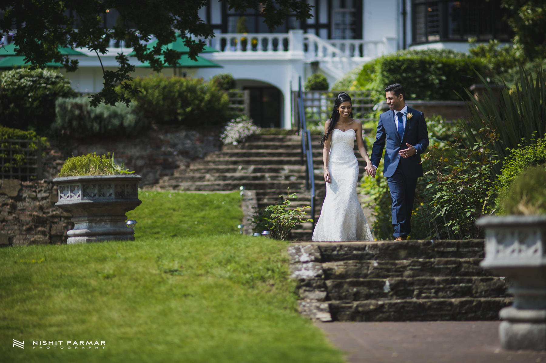 Civil Wedding Laura Ashley Manor Elstree London Wedding Photographer - bride and groom walking