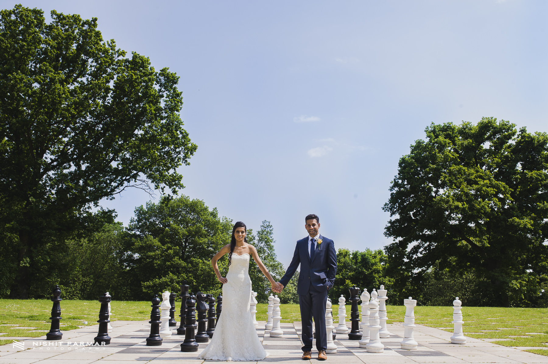 Civil Wedding Laura Ashley Manor Elstree London Wedding Photographer - bride and groom portrait in landscaped garden chess pieces