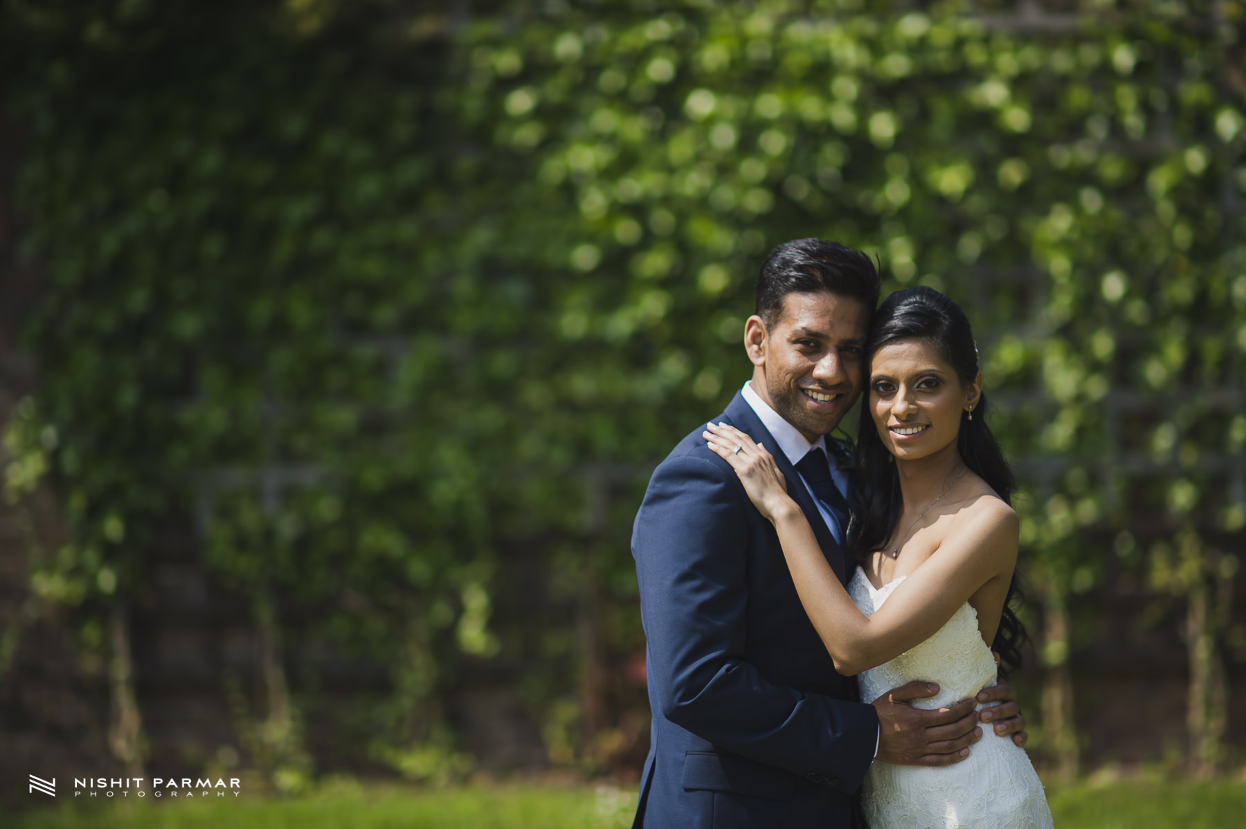 Civil Wedding Laura Ashley Manor Elstree London Wedding Photographer - bride and groom portrait in landscaped garden