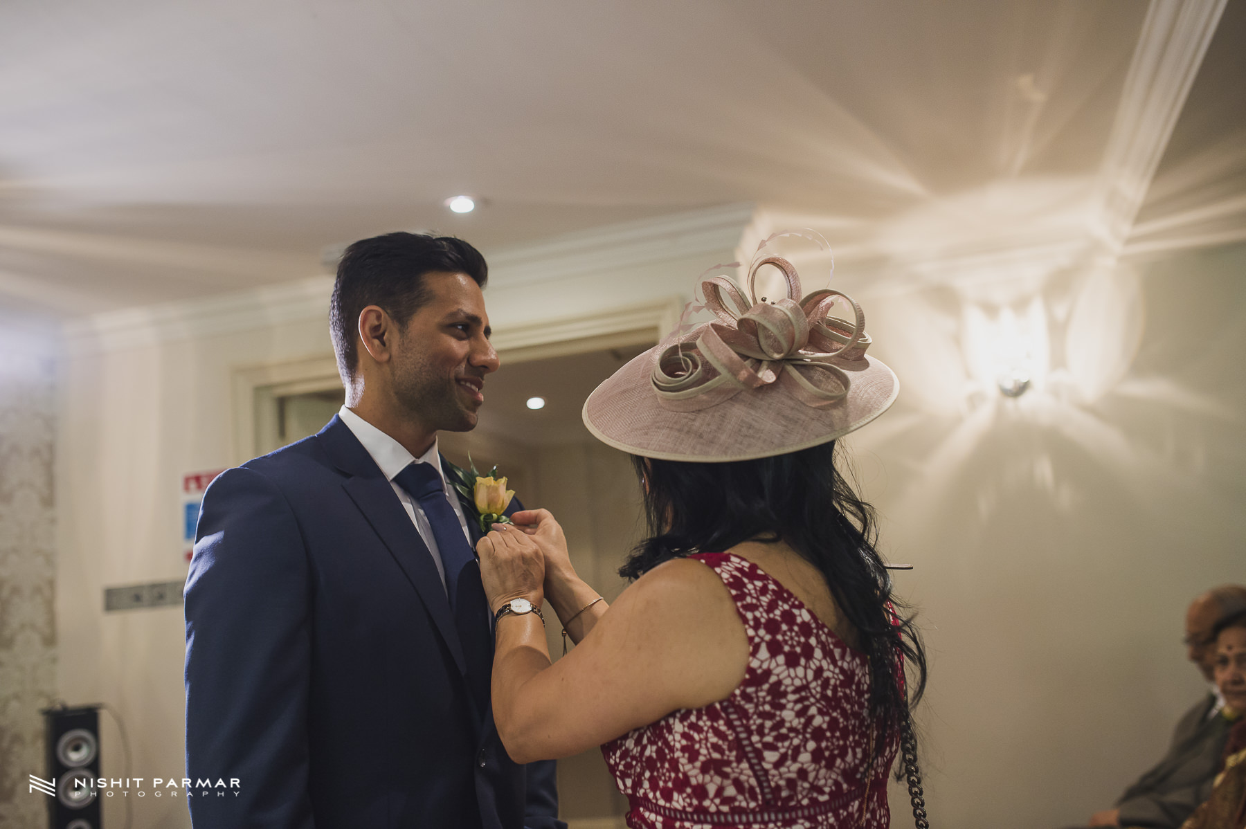 Civil Wedding Laura Ashley Manor Elstree London Wedding Photographer - Groom having buttonhole adjusted