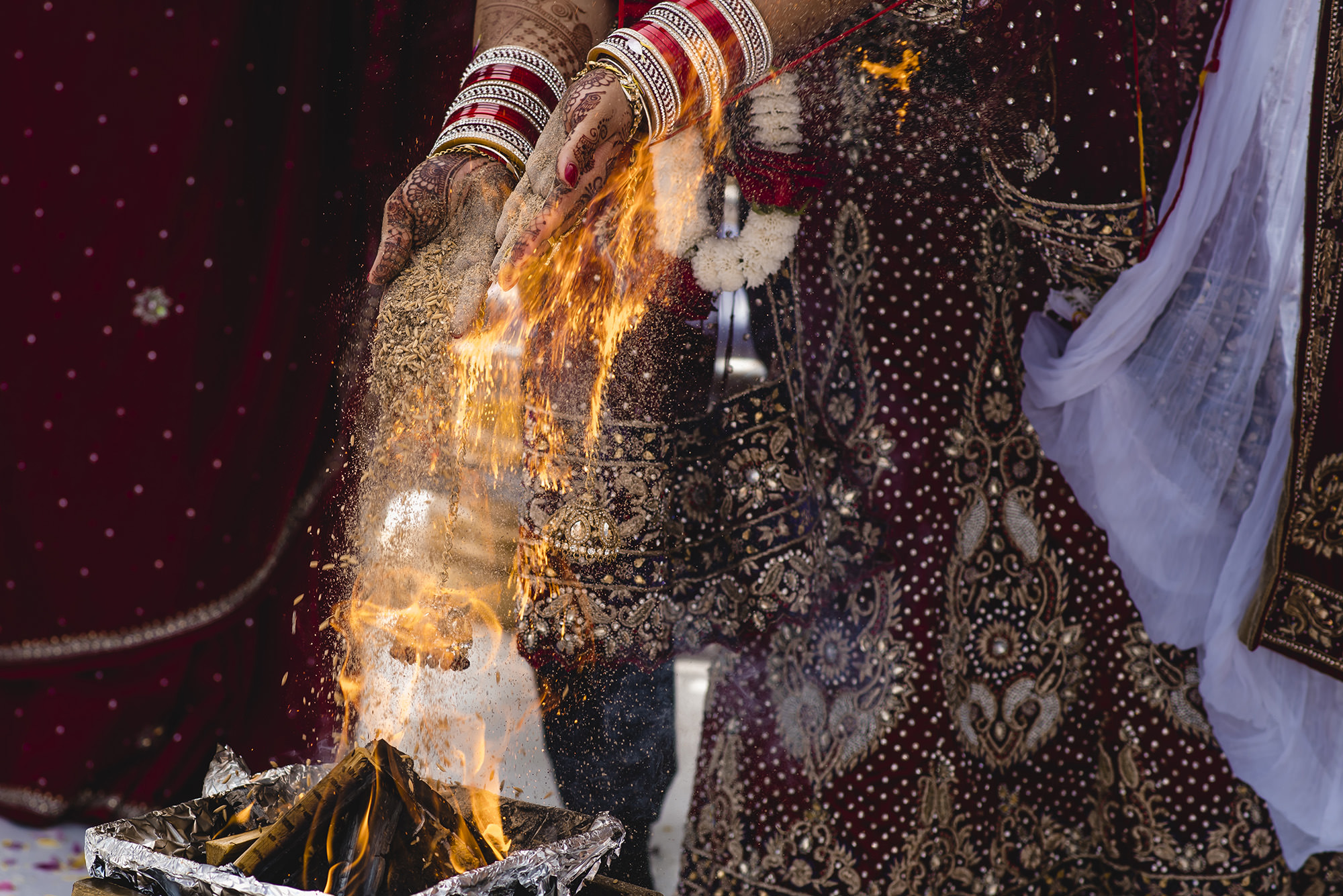 bride and groom feeding the holy fire