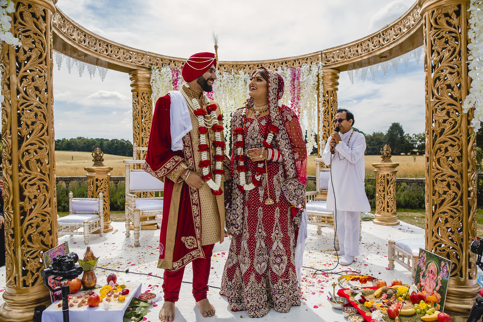 bride and groom standing in the mandap