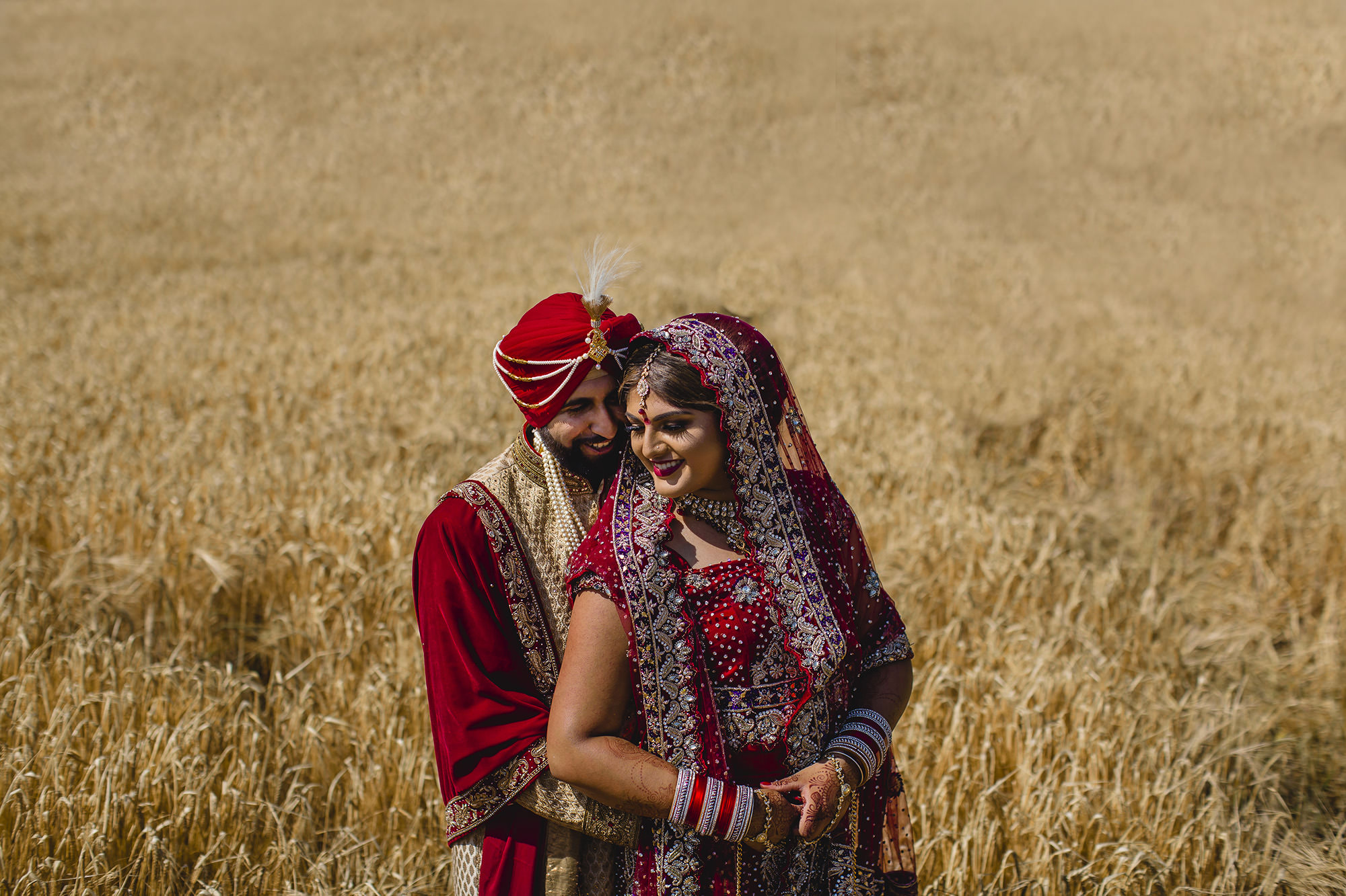 couple portraits at quendon hall in field