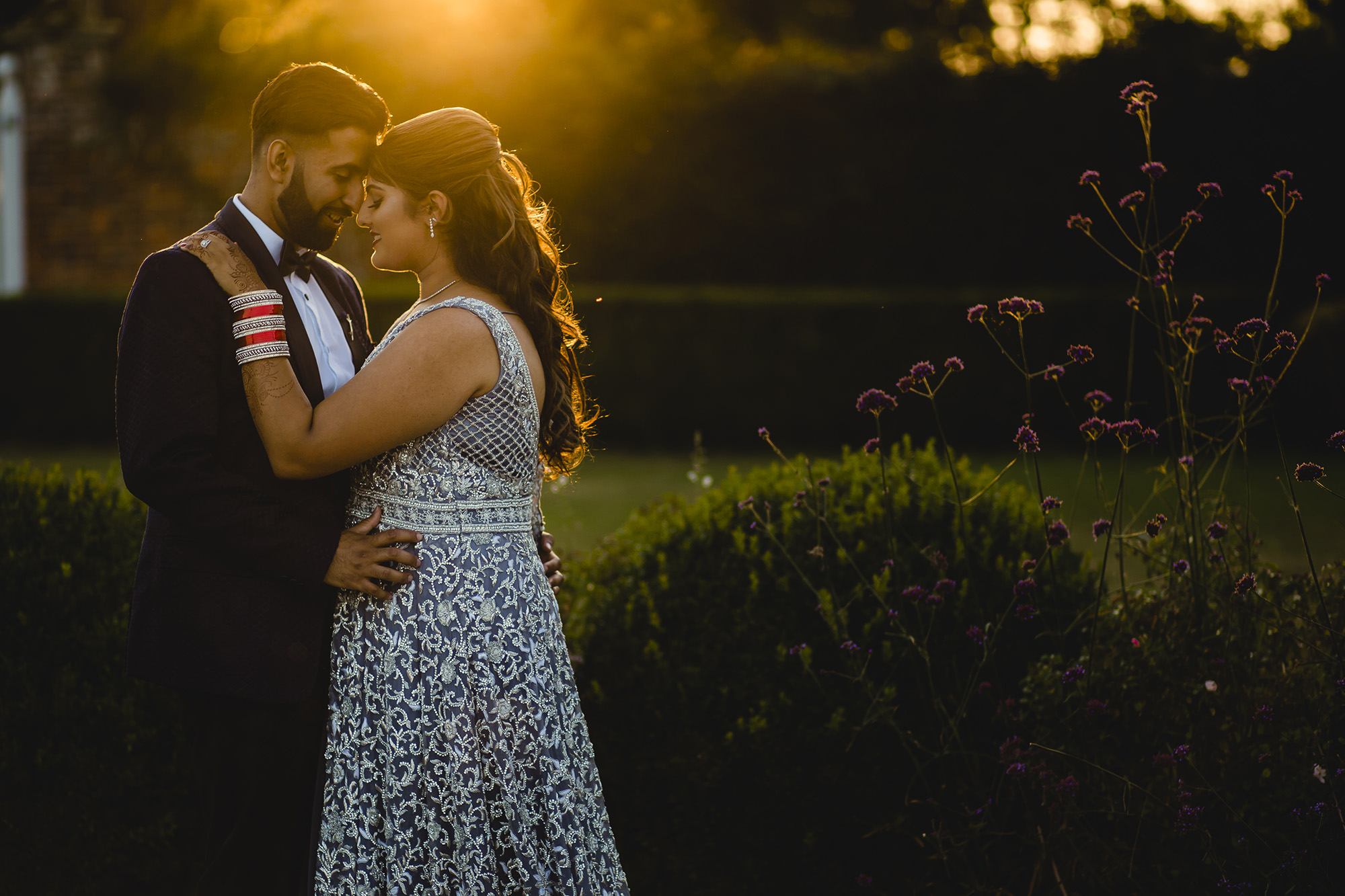 golden hour flair couple portrait with bride and groom