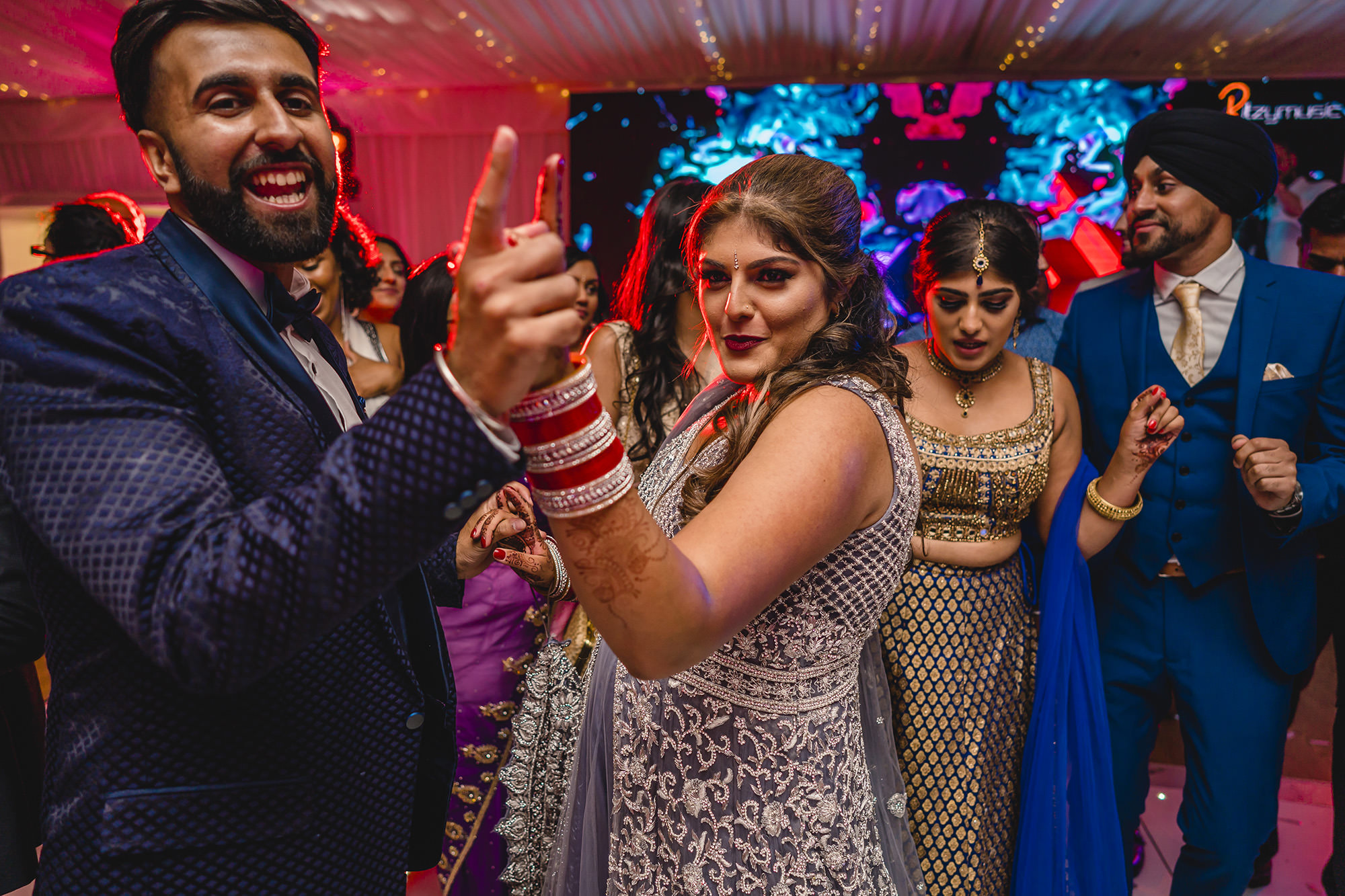 bride dancing on the dancefloor with friends and family