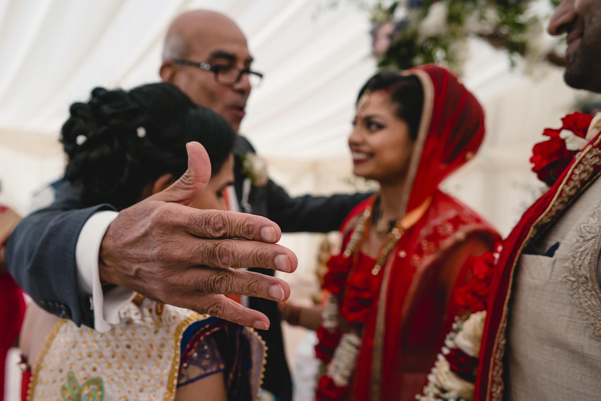 hindu wedding leaving ceremony father hugs bride
