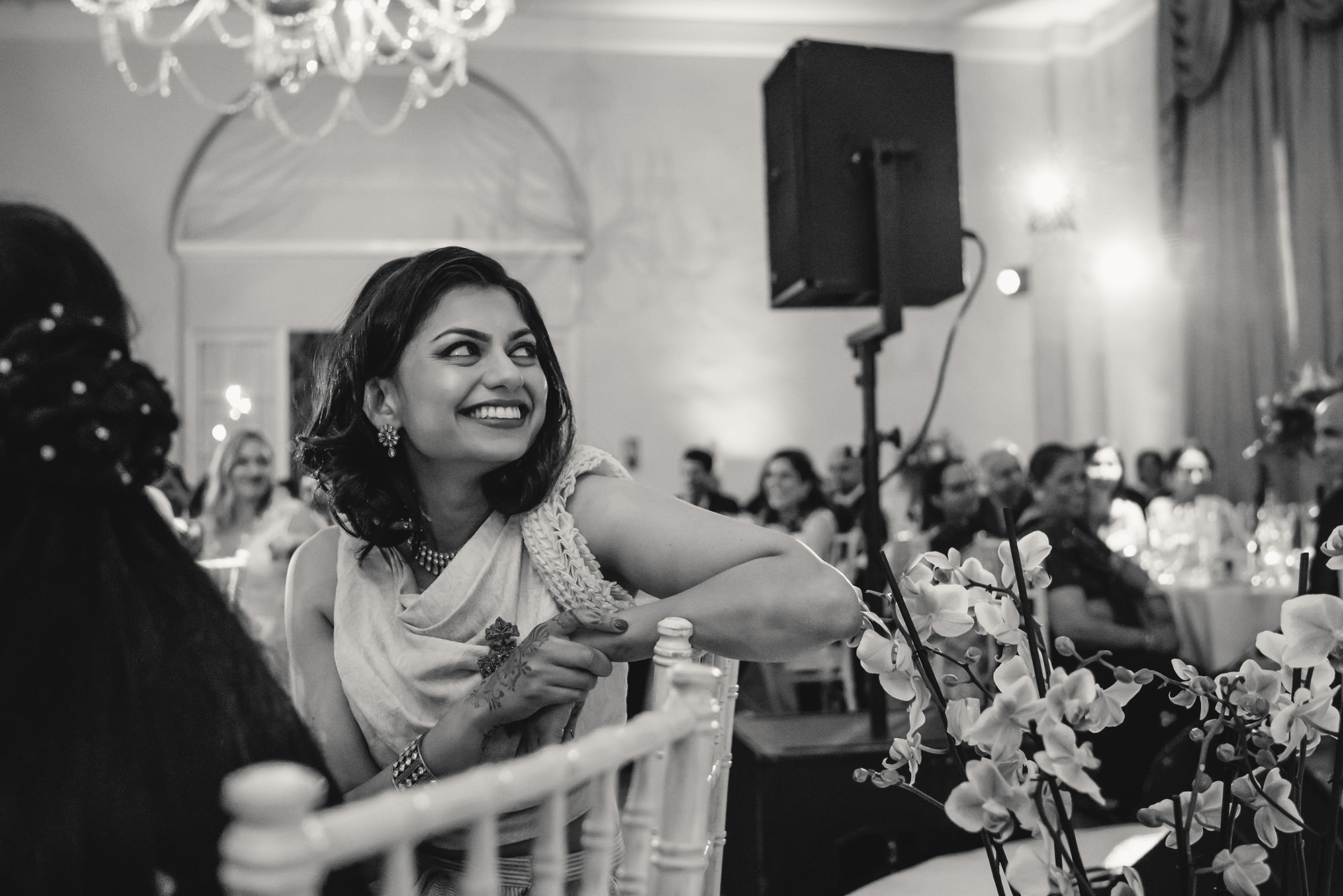 bride watching speeches at wedding reception at stapleford park