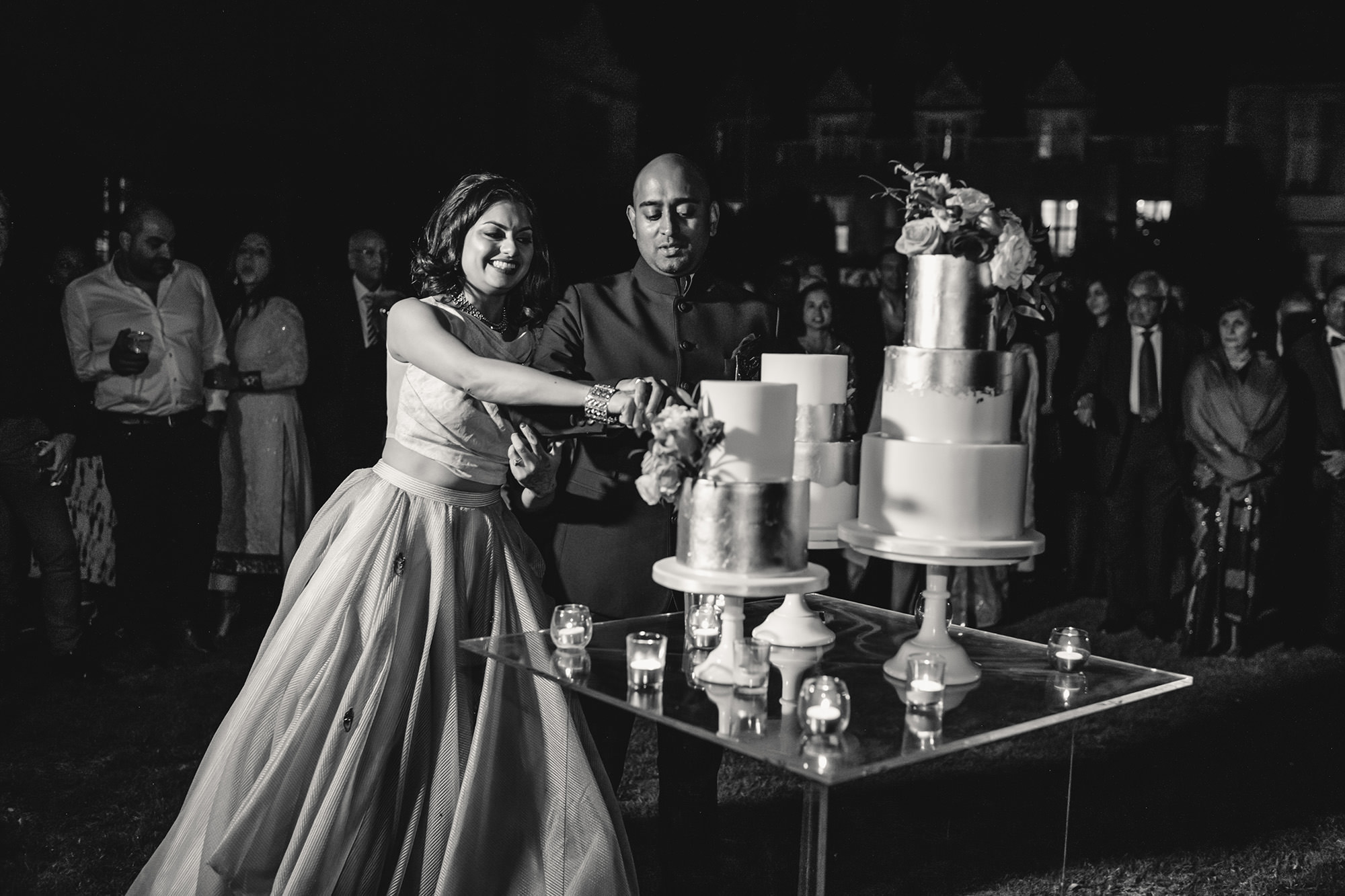 bride and groom cutting wedding cake at stapleford park