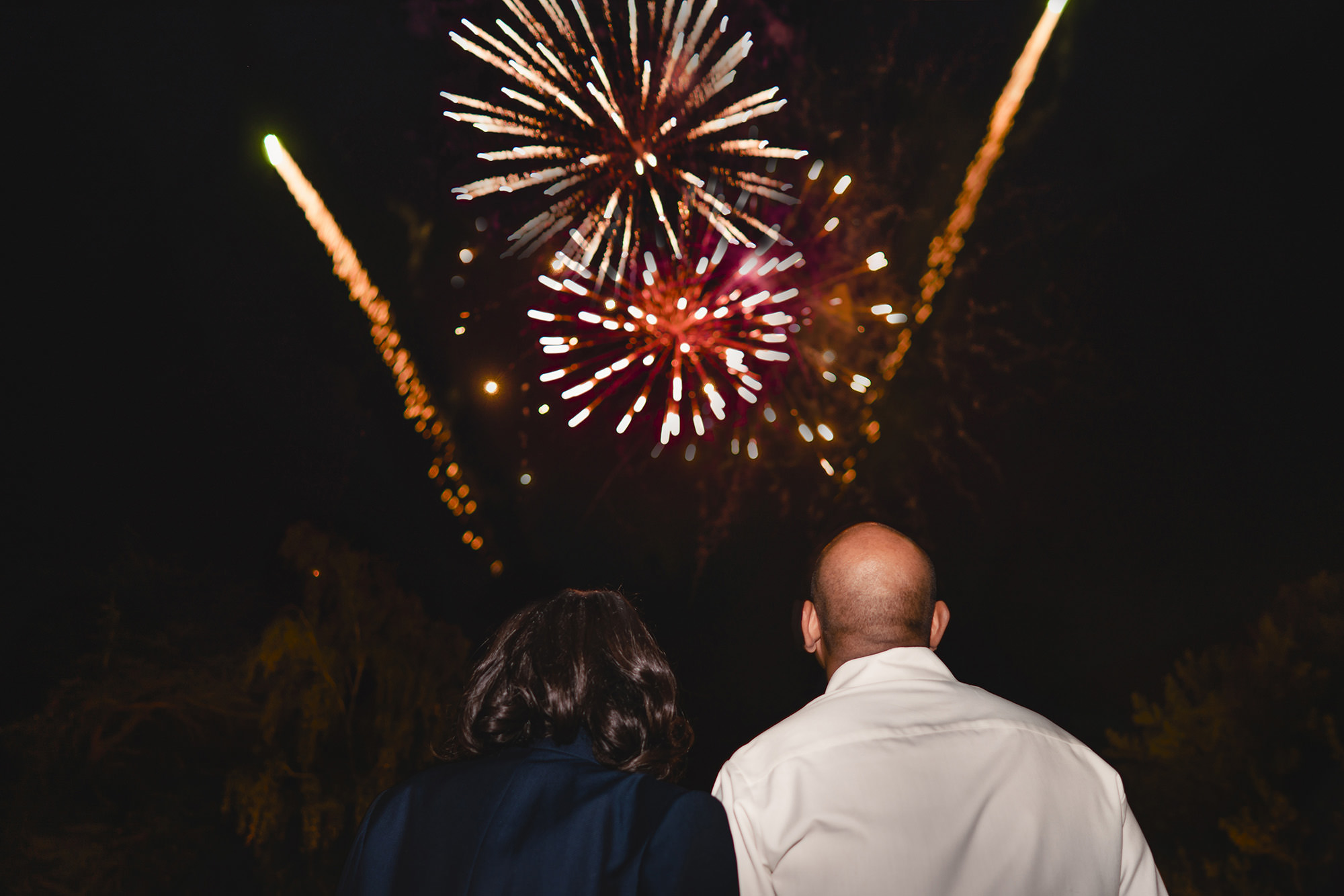 bride and groom watching fireworks at stapleford park