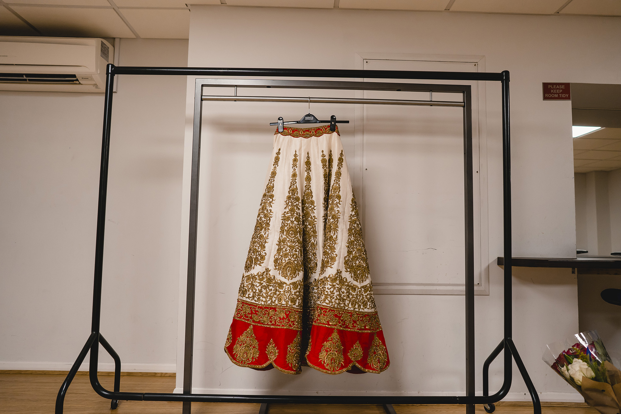 brides lengha hanging before the wedding ceremony