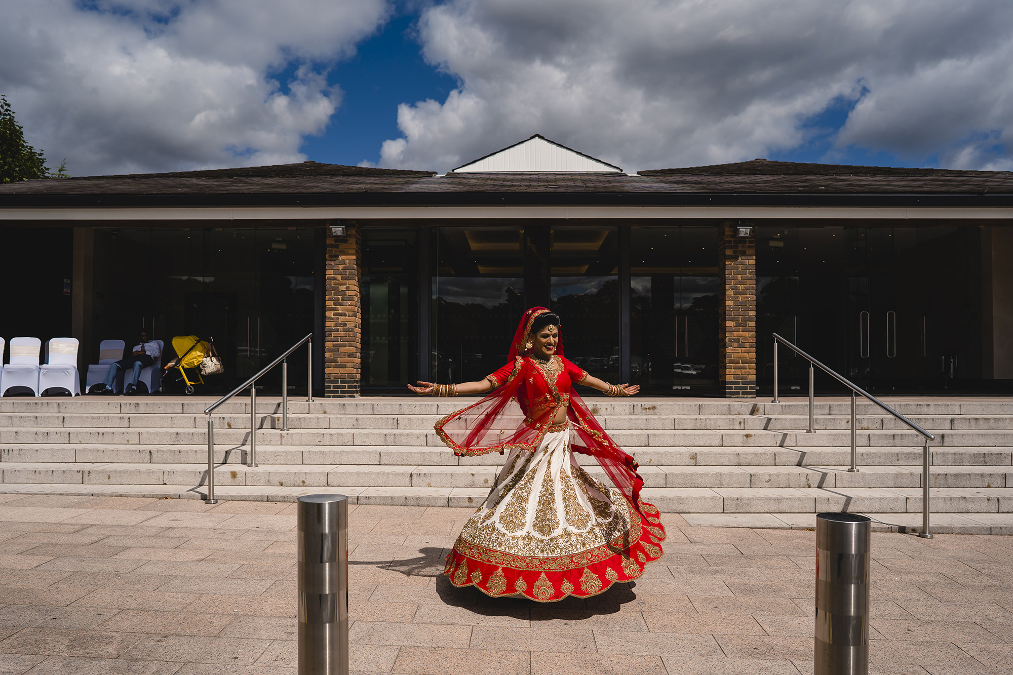 bride twirling in her indian wedding lengha at oshwal house