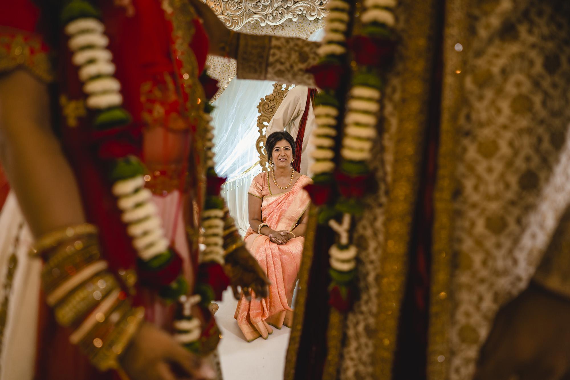 bride and groom exchange garlands