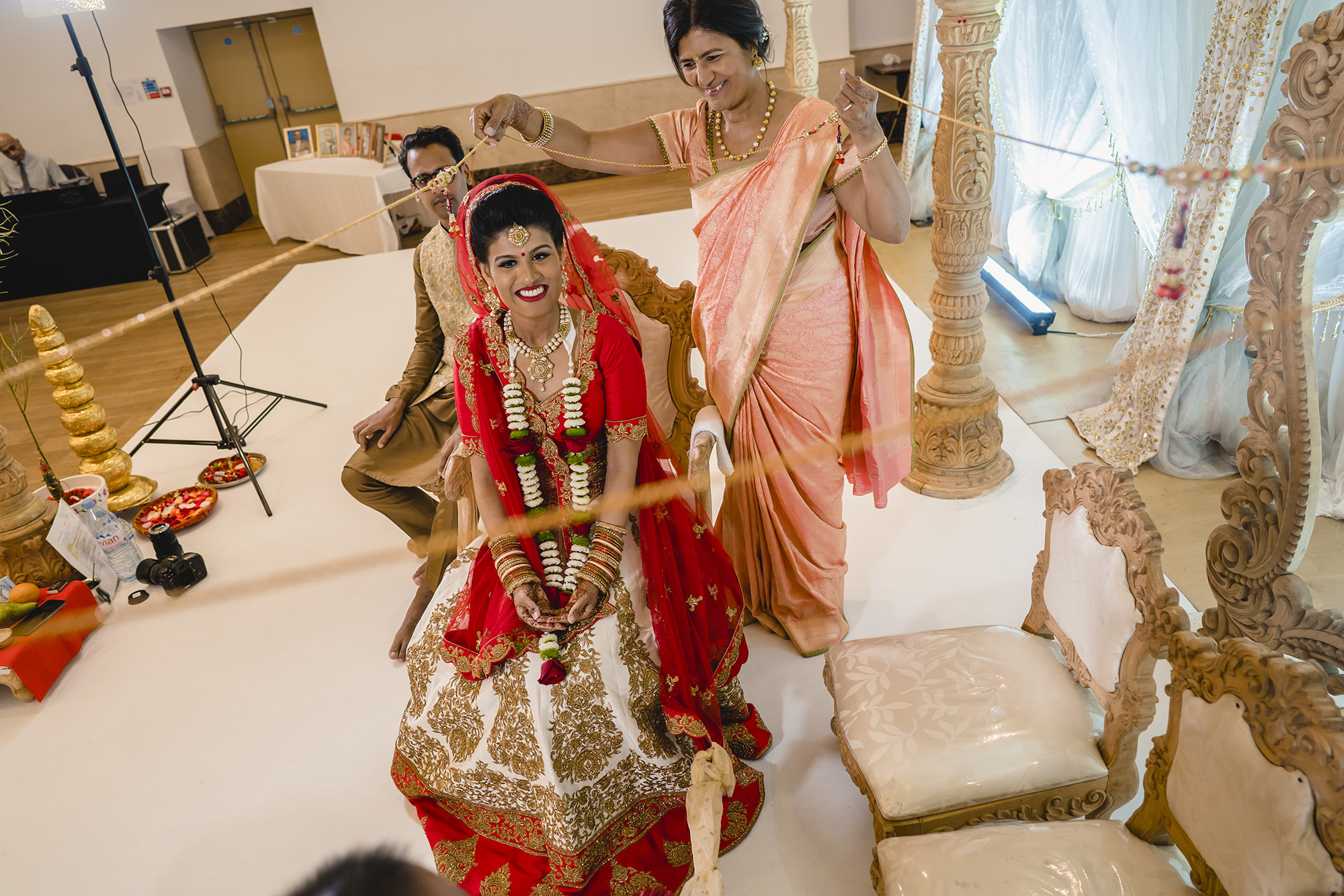 bride and her mum during the hindu wedding ceremony
