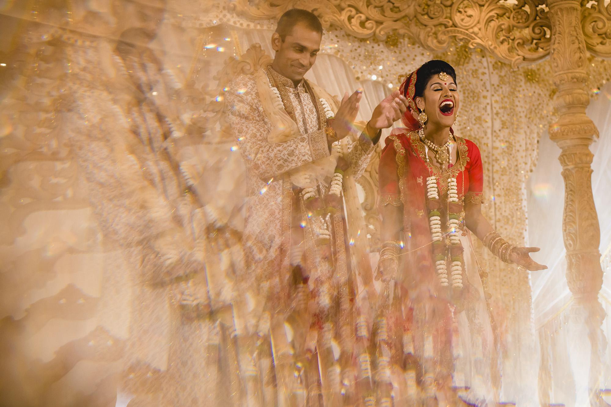 expressive bride in the mandap