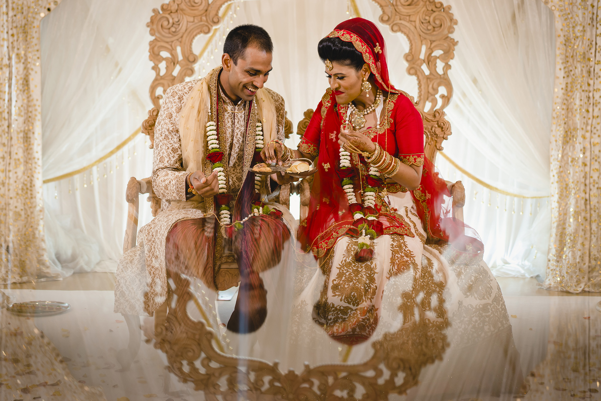 bride and groom enjoying themselves in the mandap