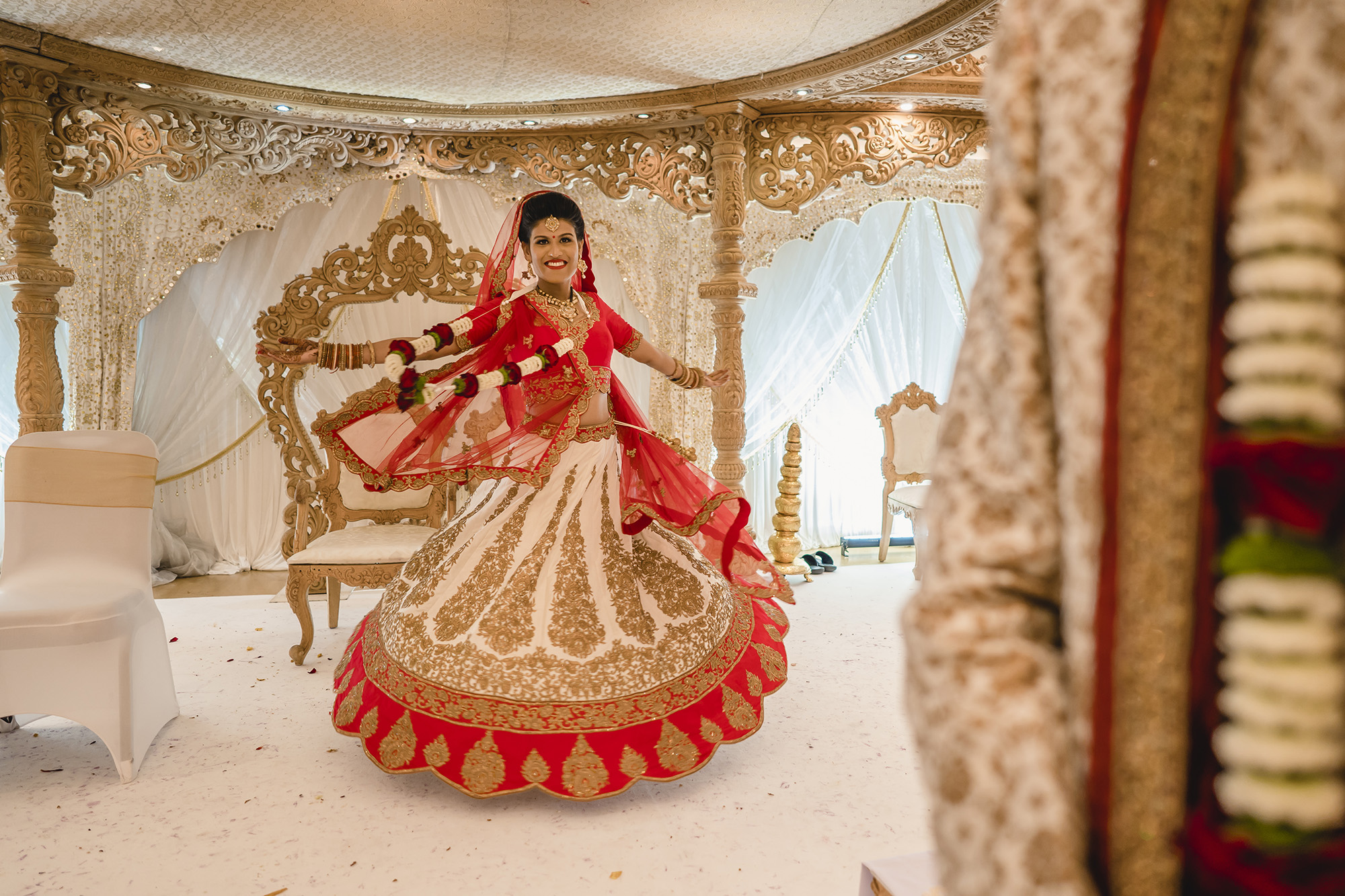 bride twirling in the mandap after her hindu wedding