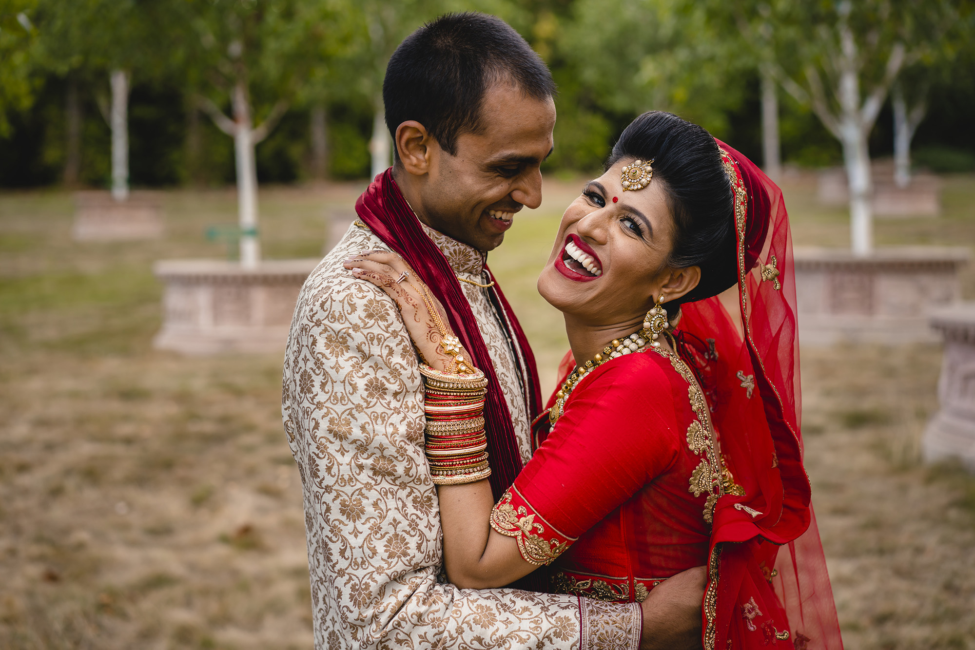 portrait of the bride and groom in their indian wedding outfits