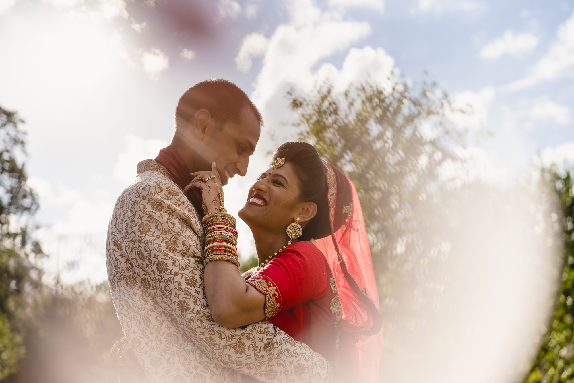 bride and groom portrait outside oshwal house
