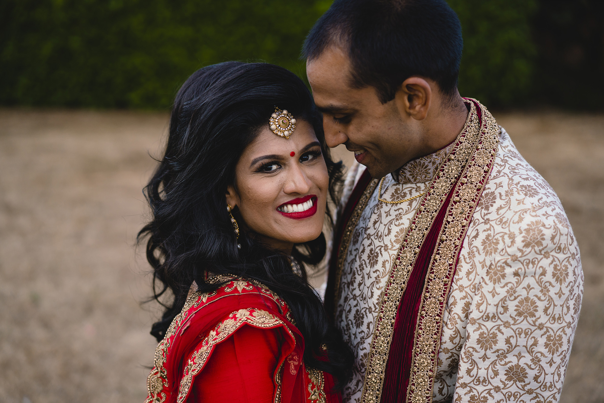 bride and groom portrait at oshwal house