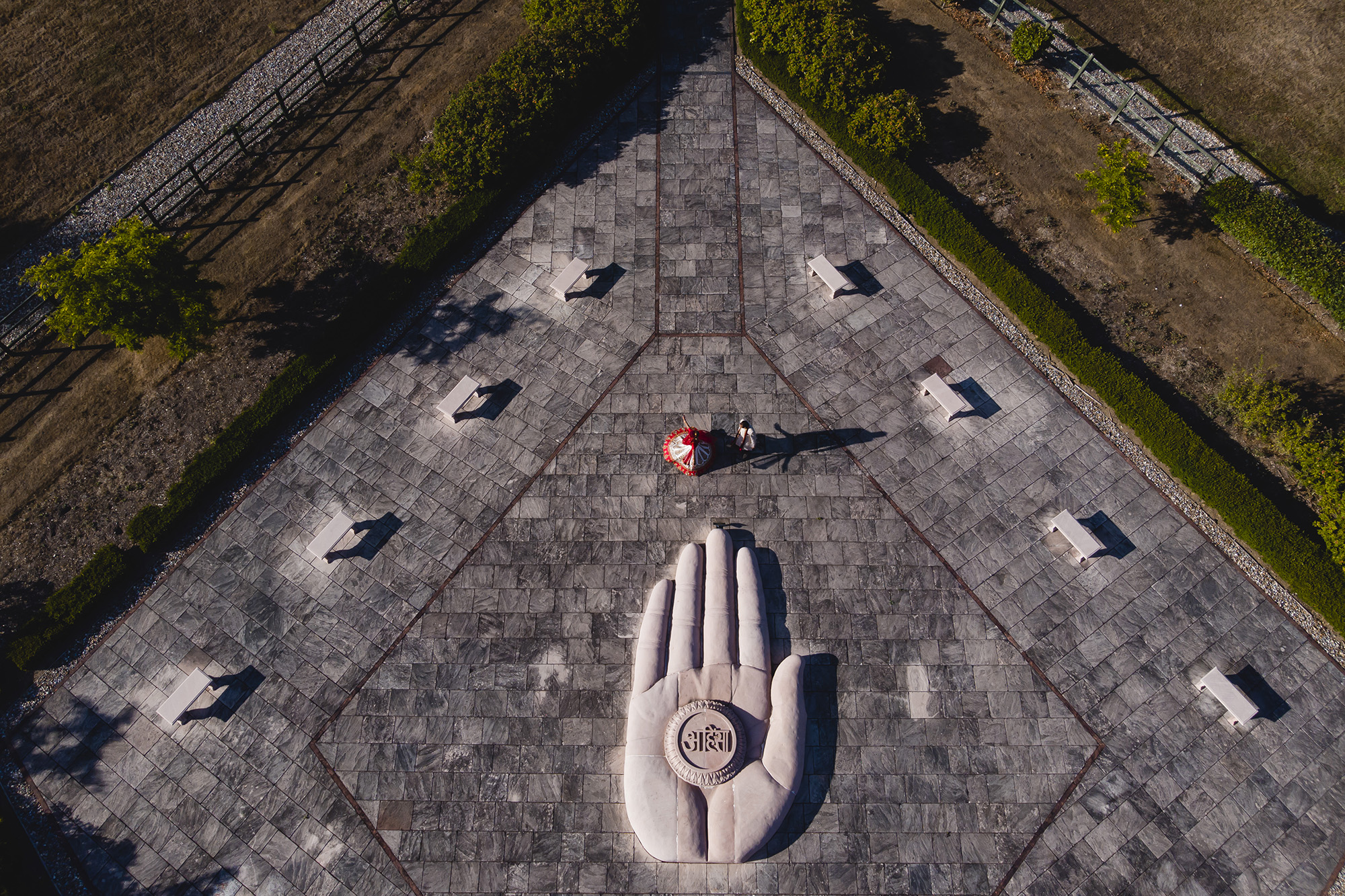 drone picture of bride and groom at oshwal centre