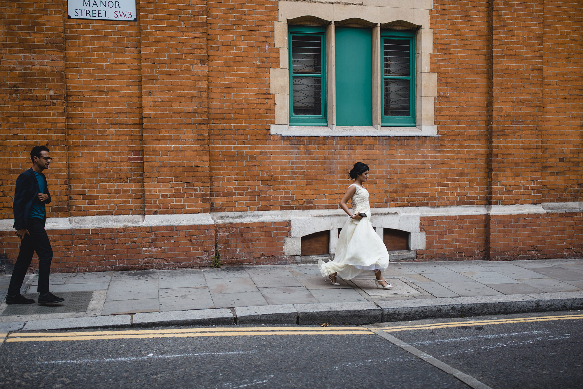 bride running to her civil ceremony in her white dress