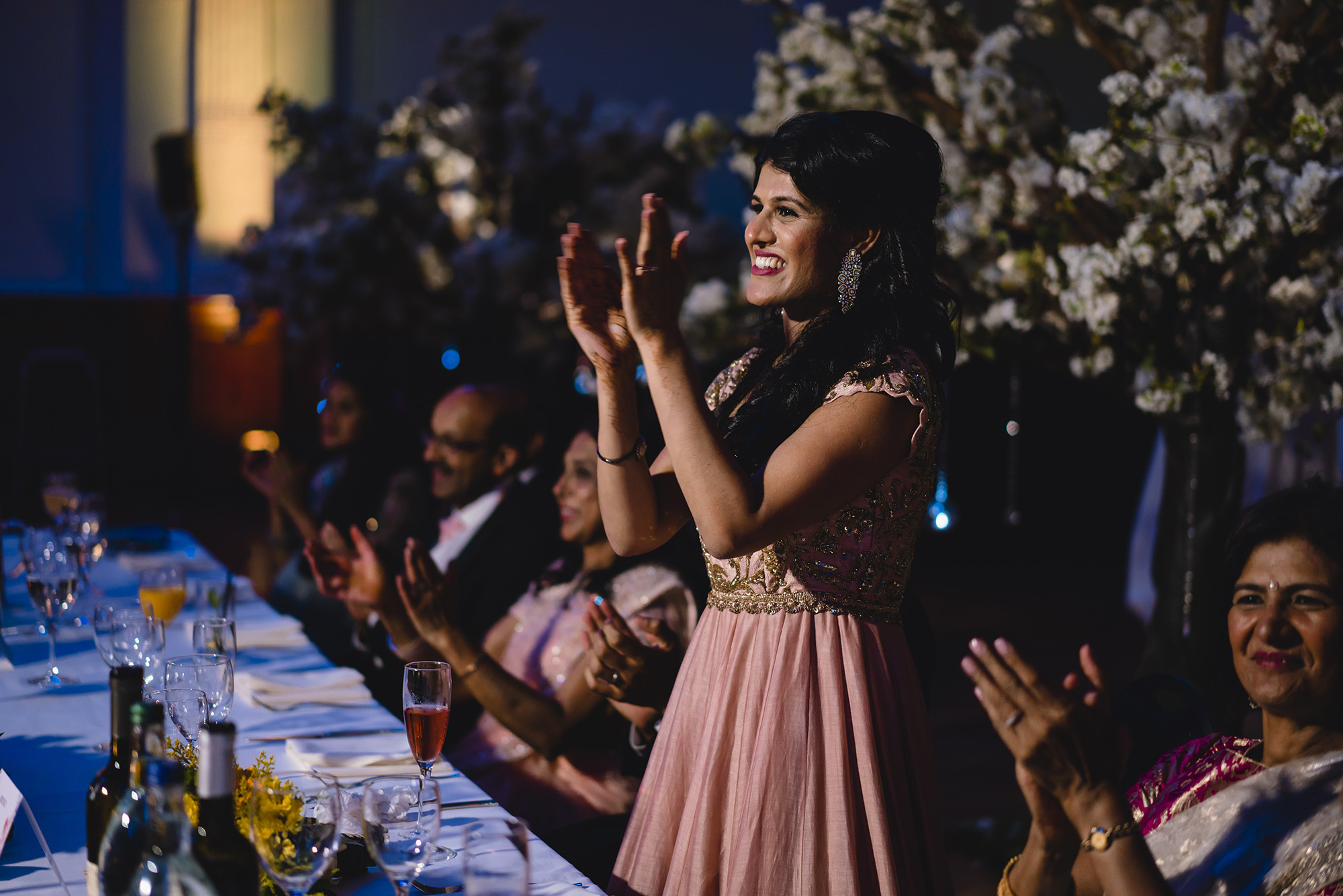 bride clapping speeches at her reception
