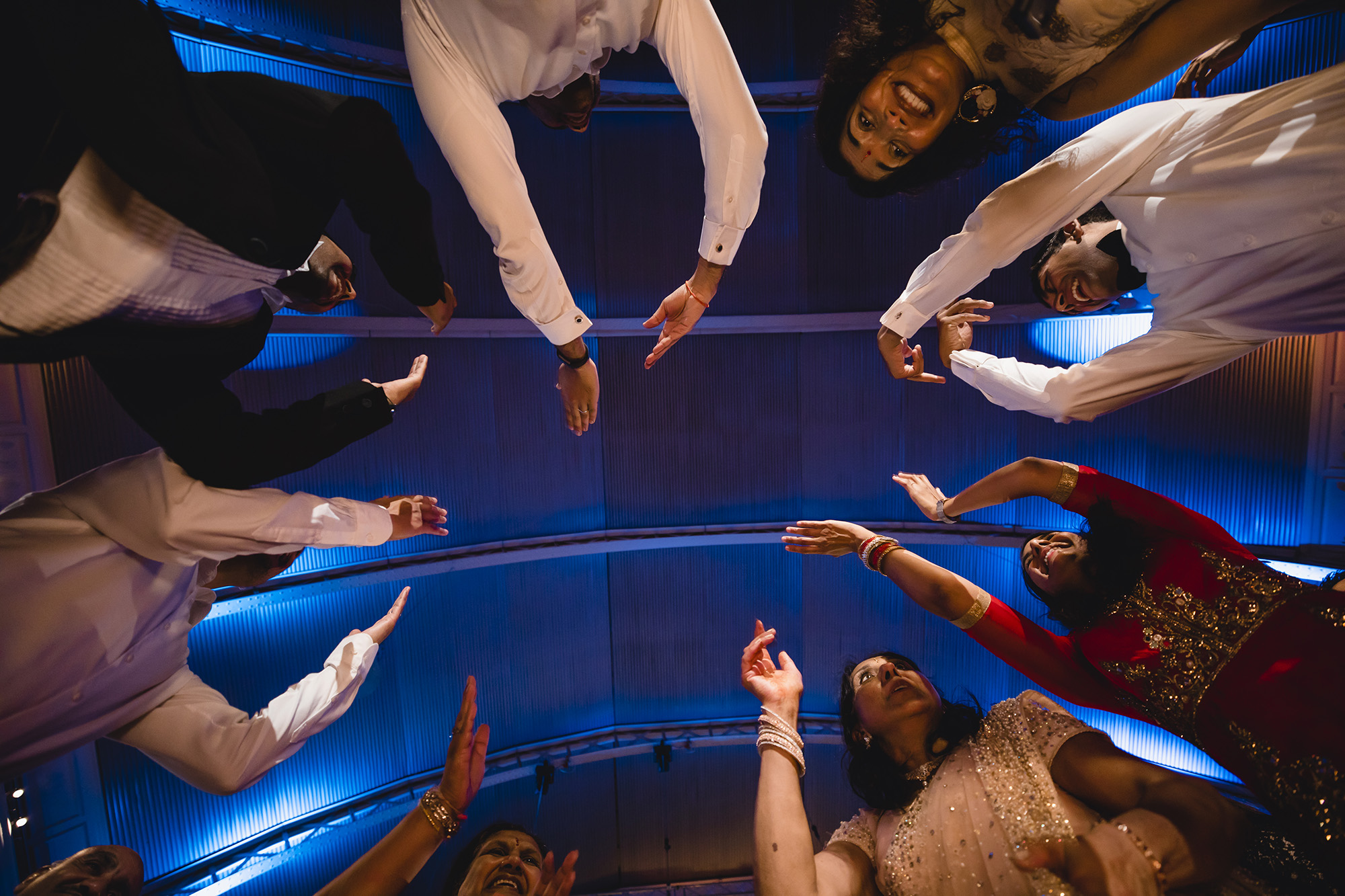 guests dancing over the camera looking up to the ceiling