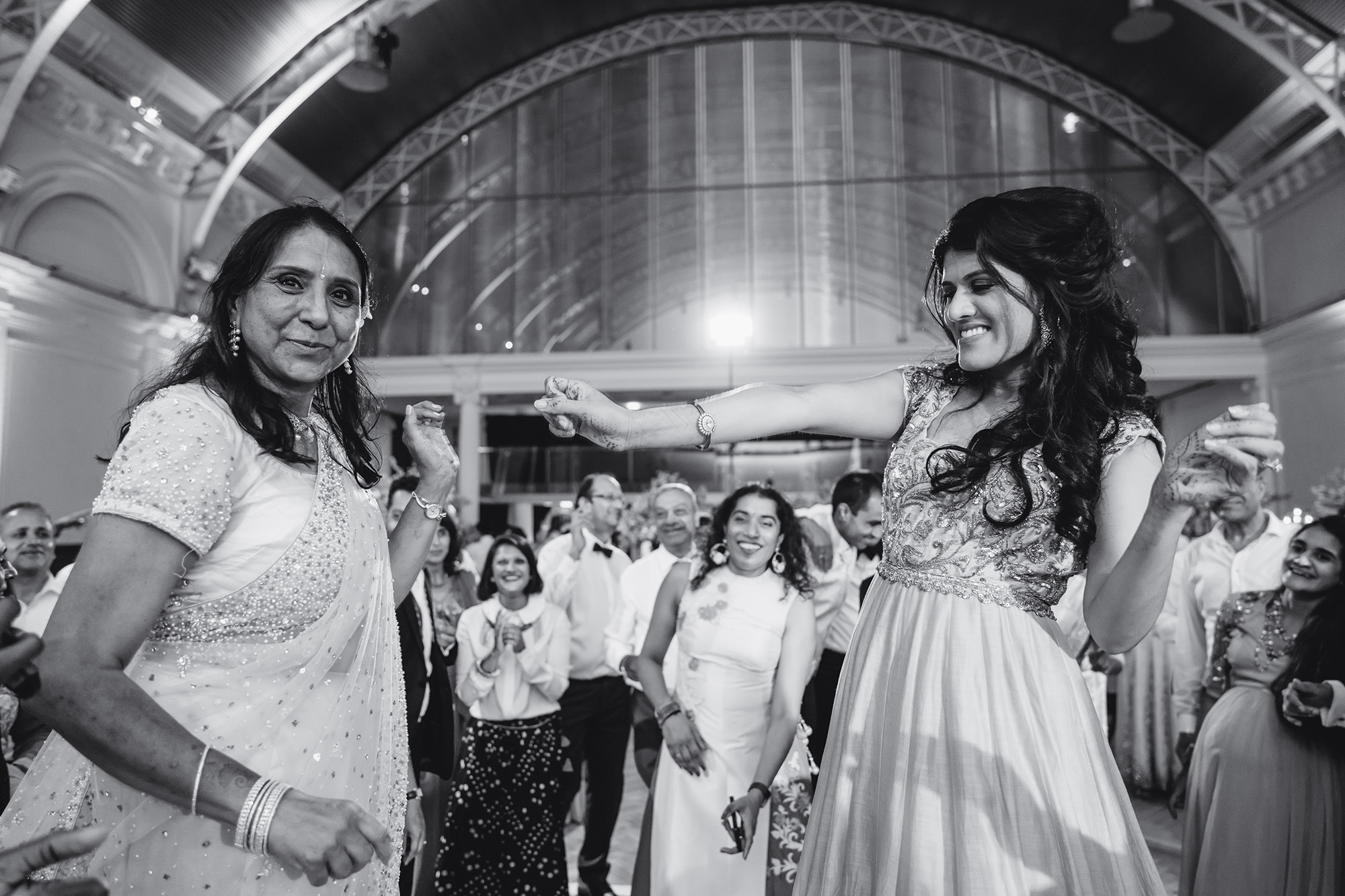 bride and mother dancing at wedding reception