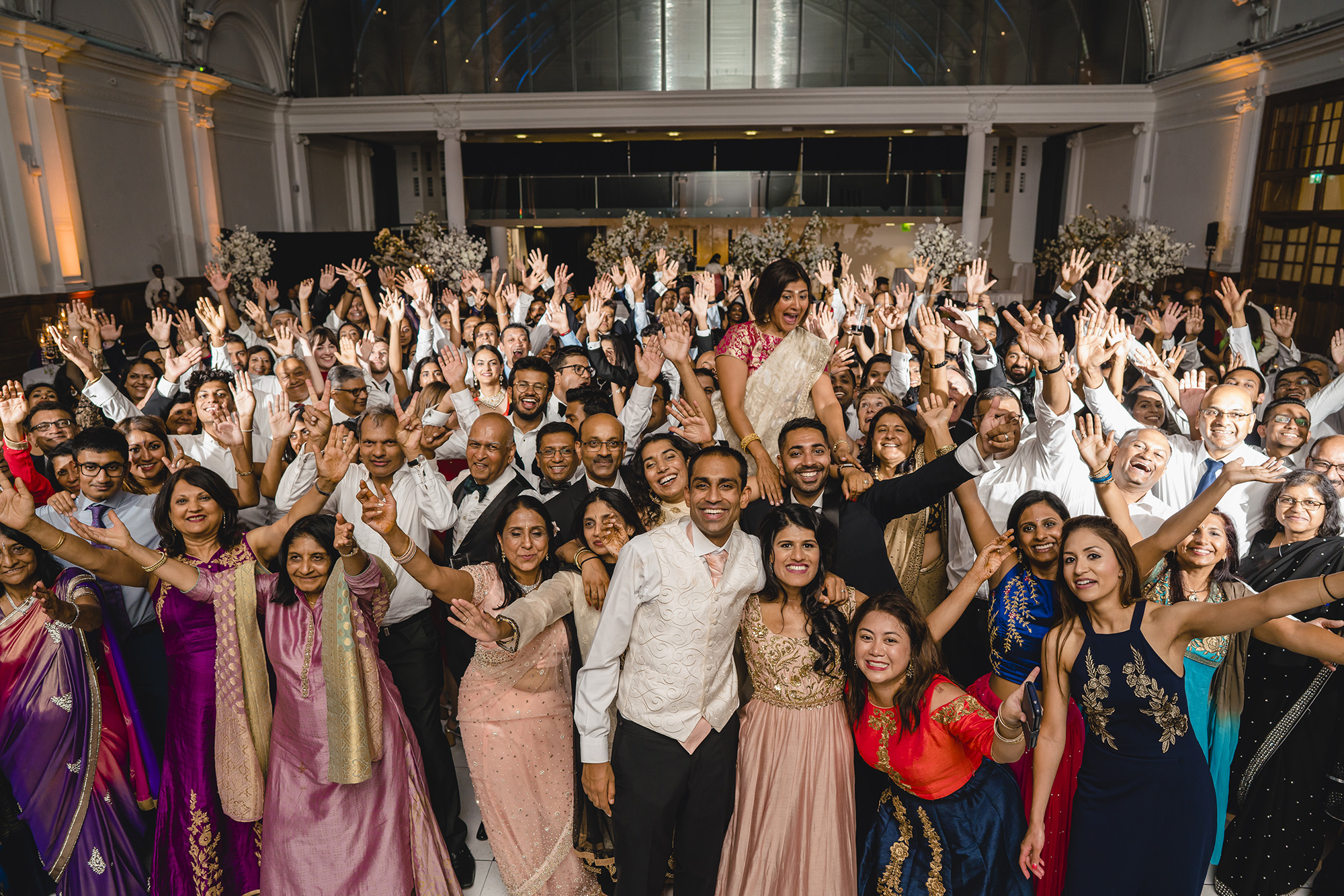 group photograph with all guests at wedding reception