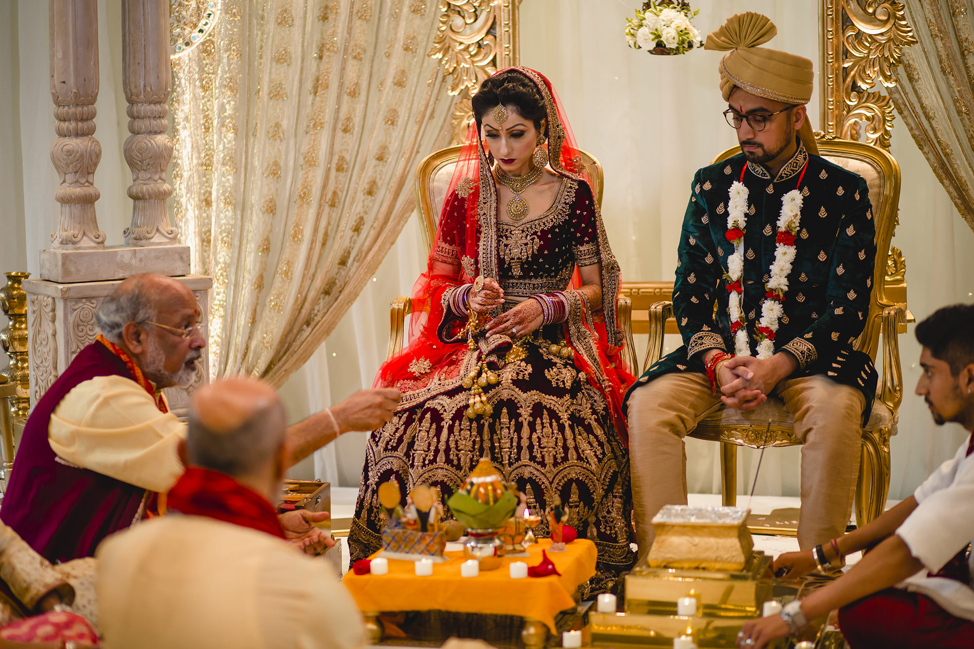 bride and groom in mandap at hindu ceremony