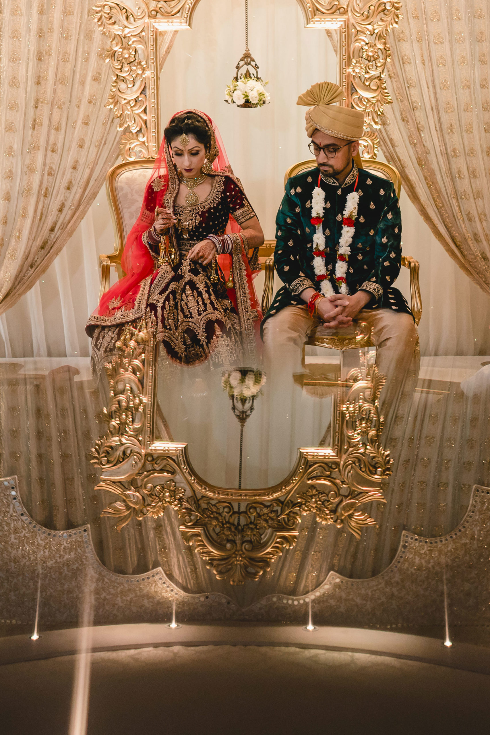 bride and groom in the mandap during hindu ceremony