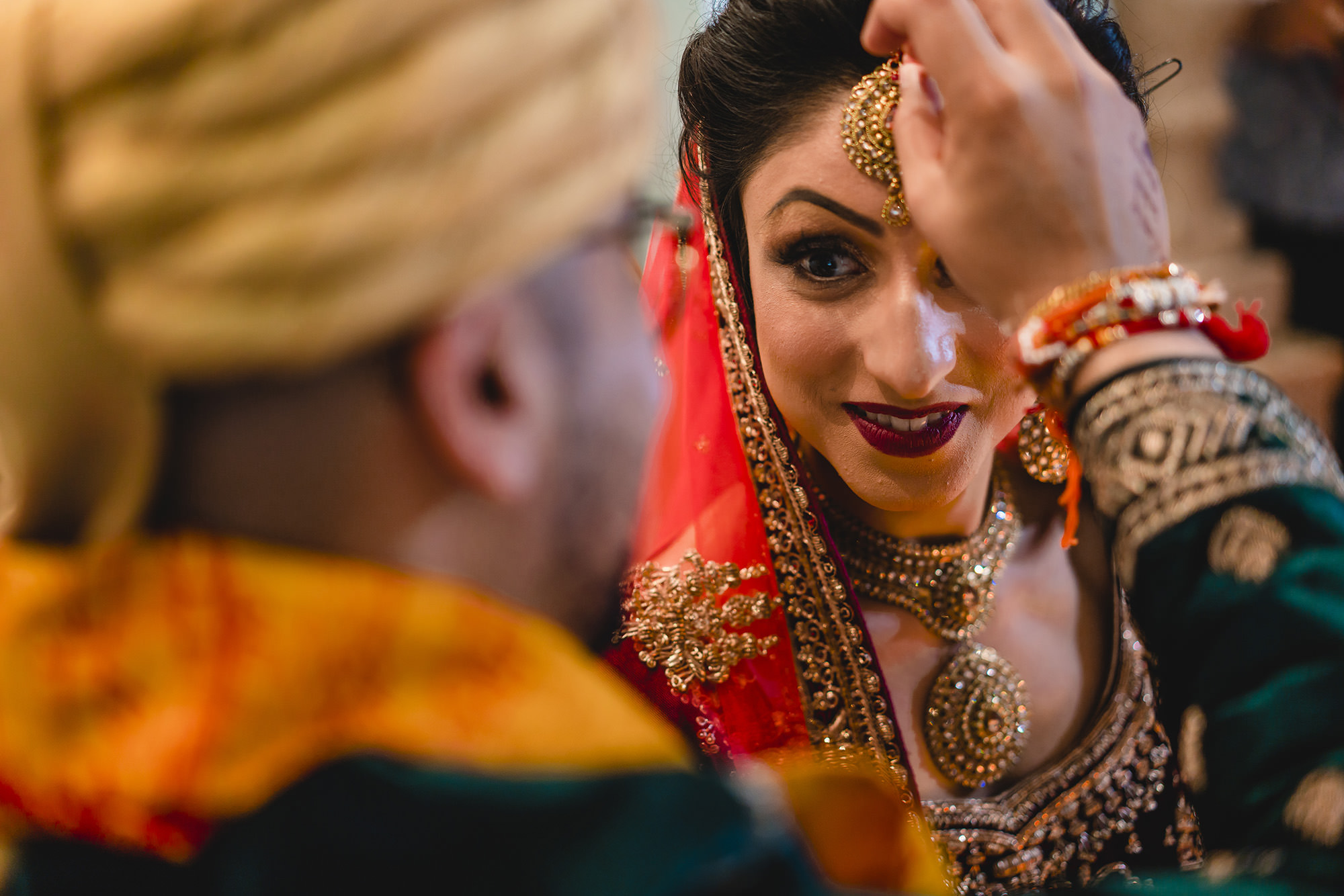 sindhoor placed on brides forehead during hindu wedding ceremony
