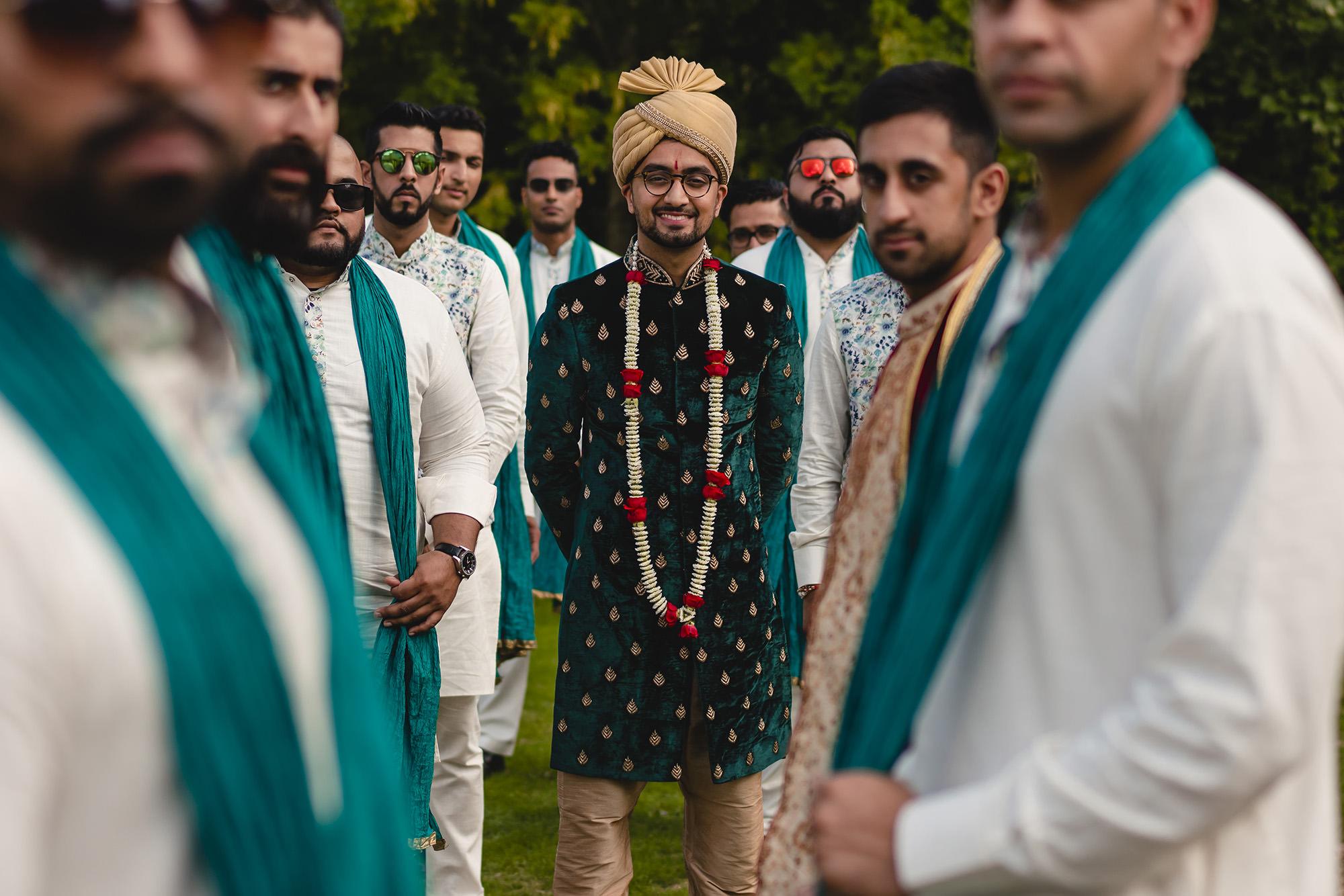 groom portrait amongst groomsmen