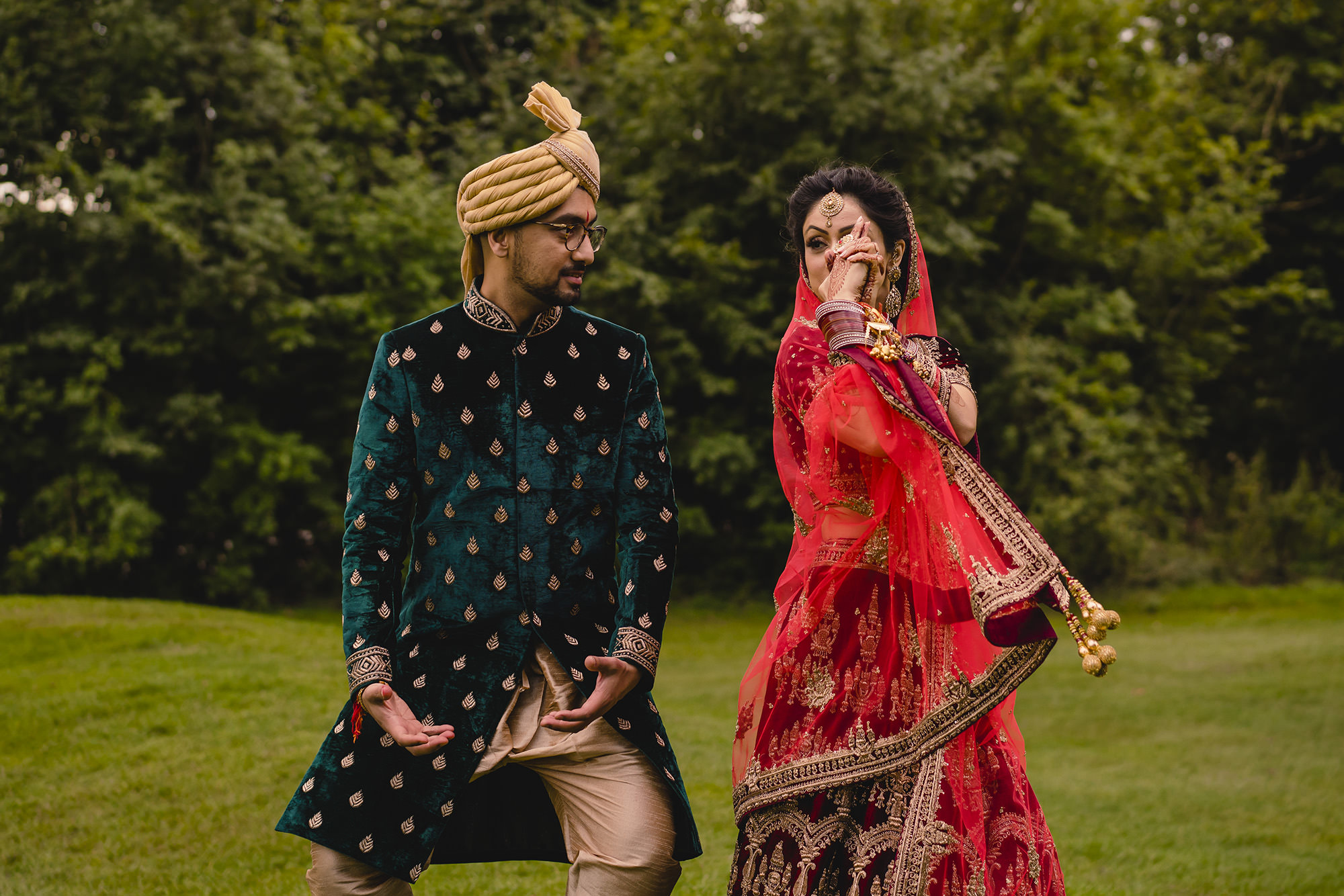 bride and groom having fun wedding lengha sherwani addington palace