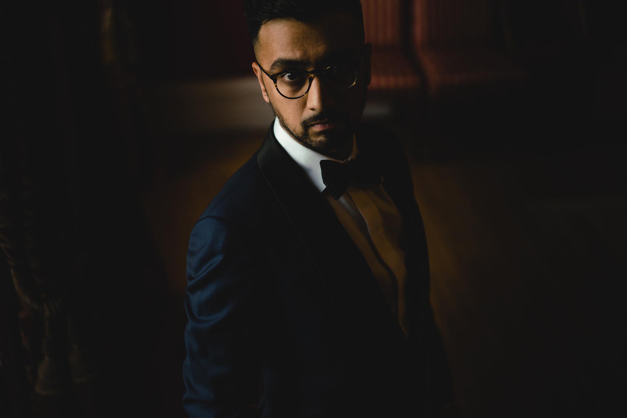 groom portrait in tuxedo