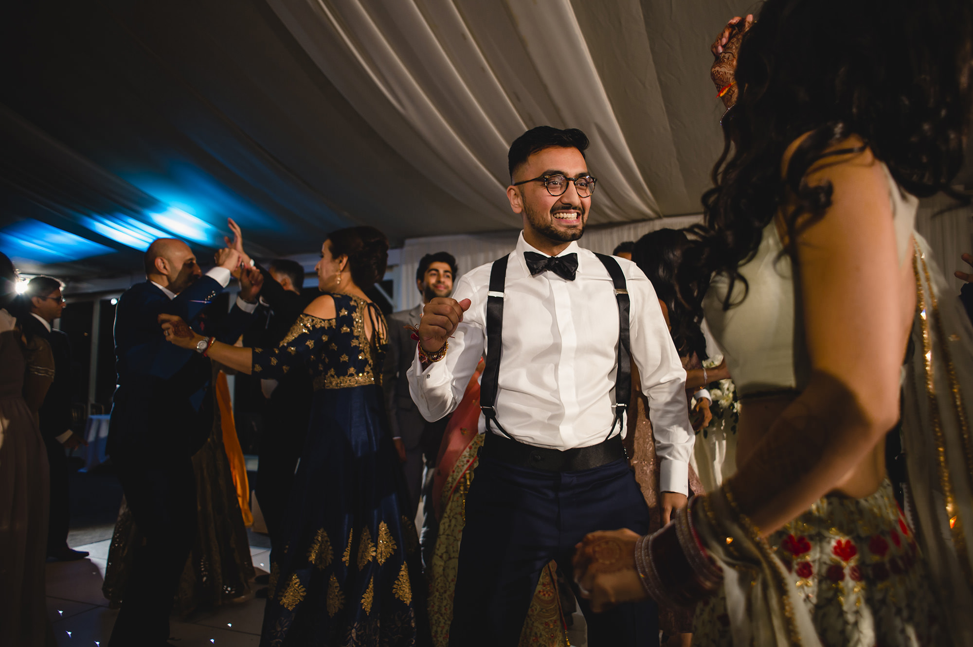 groom dancing on dance floor