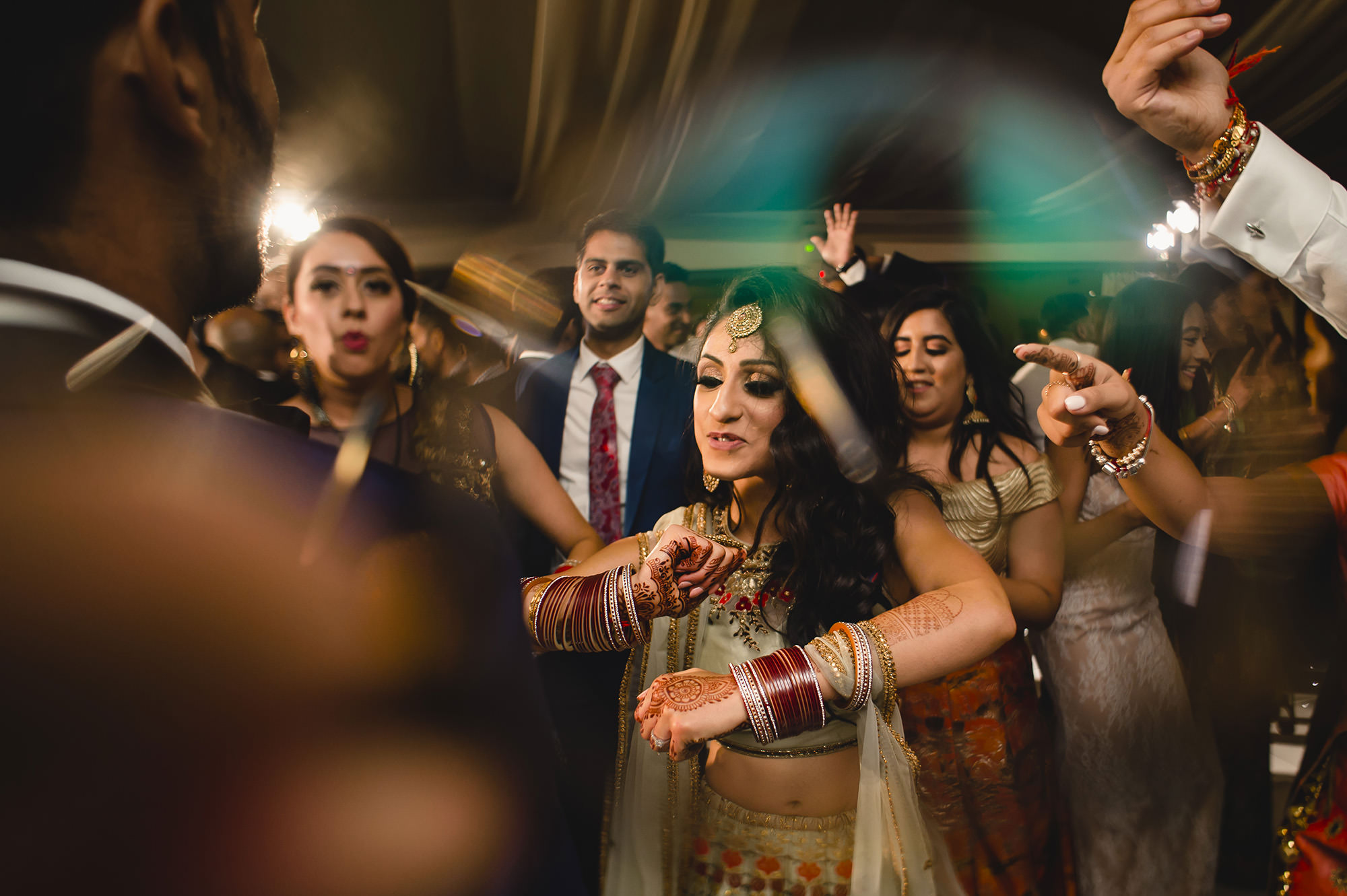 bride dancing with friends at wedding reception