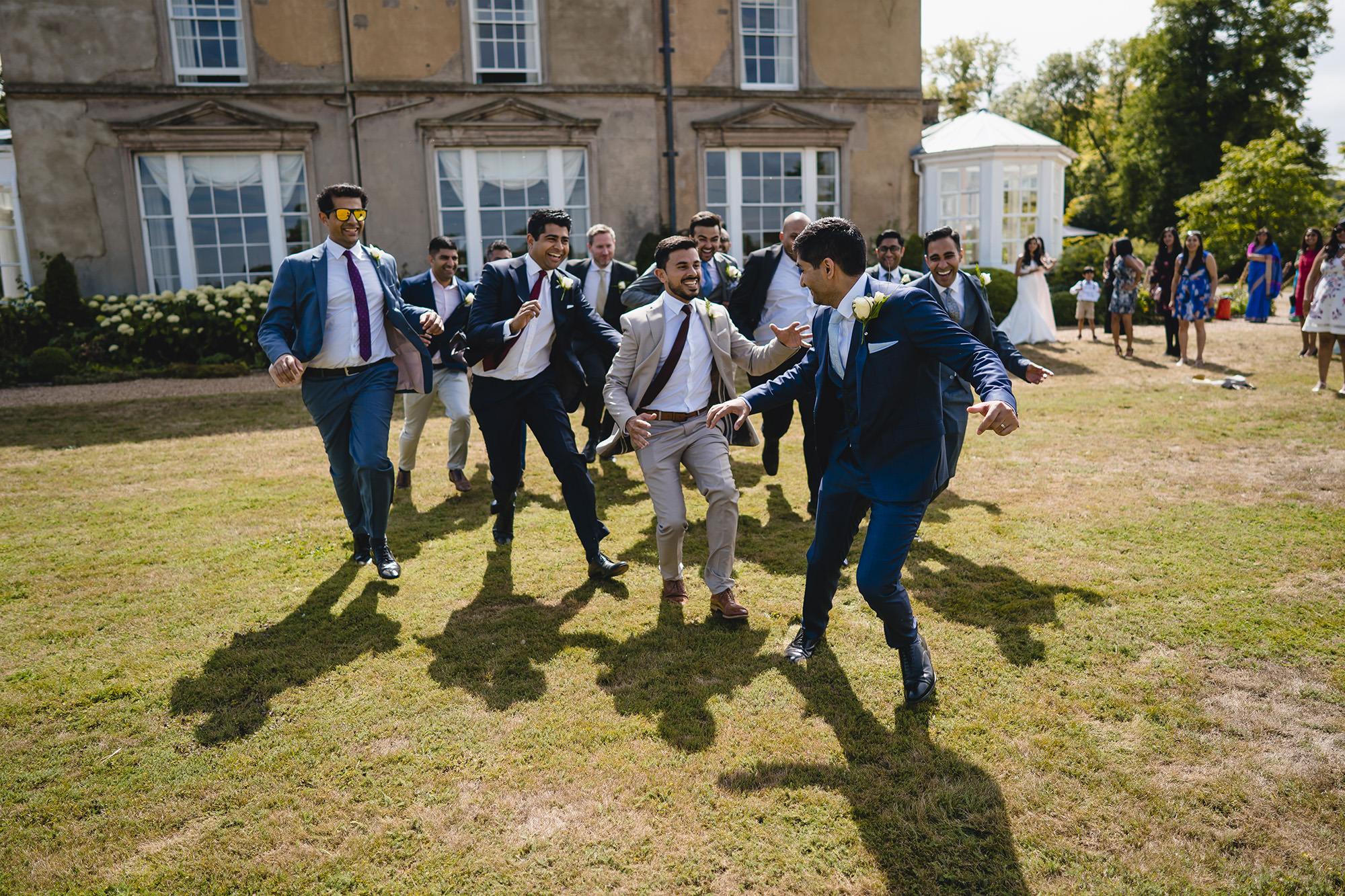 groomsmen chasing the groom