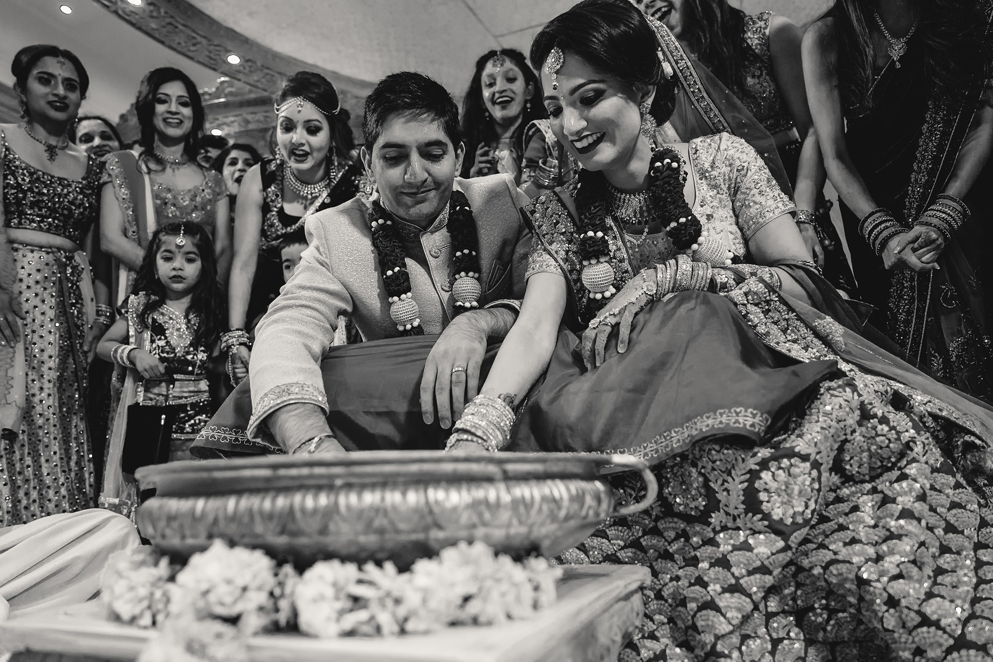 bride and groom playing traditional indian games
