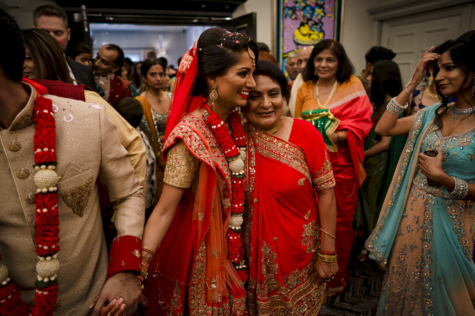 indian bride saying goodbye to her mother at the end of her hindu wedding