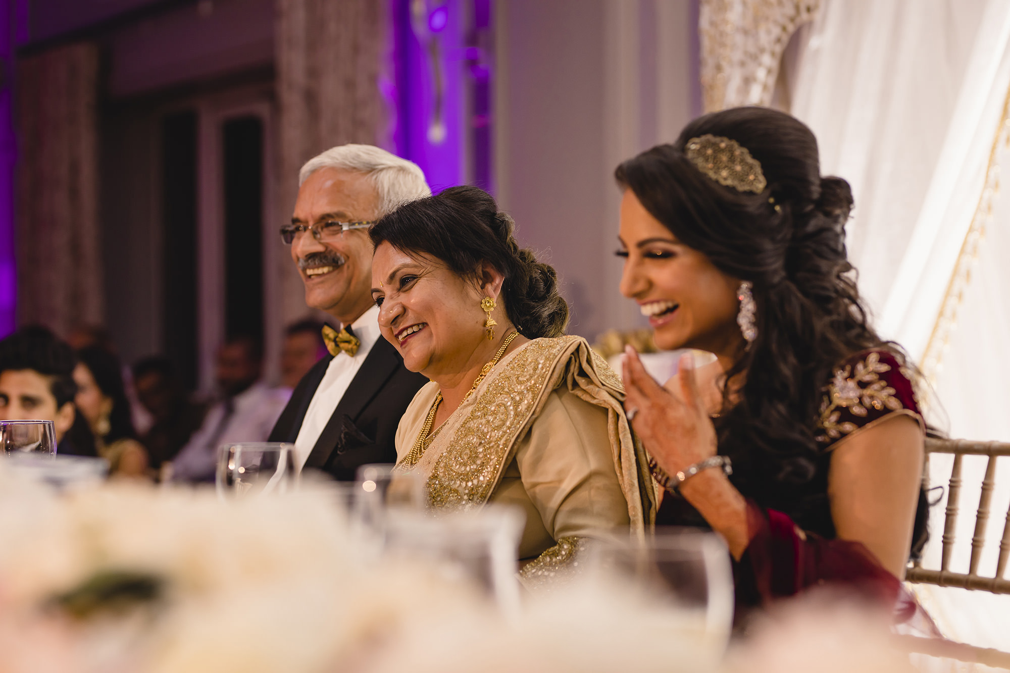 speeches and laughter by head table during wedding reception