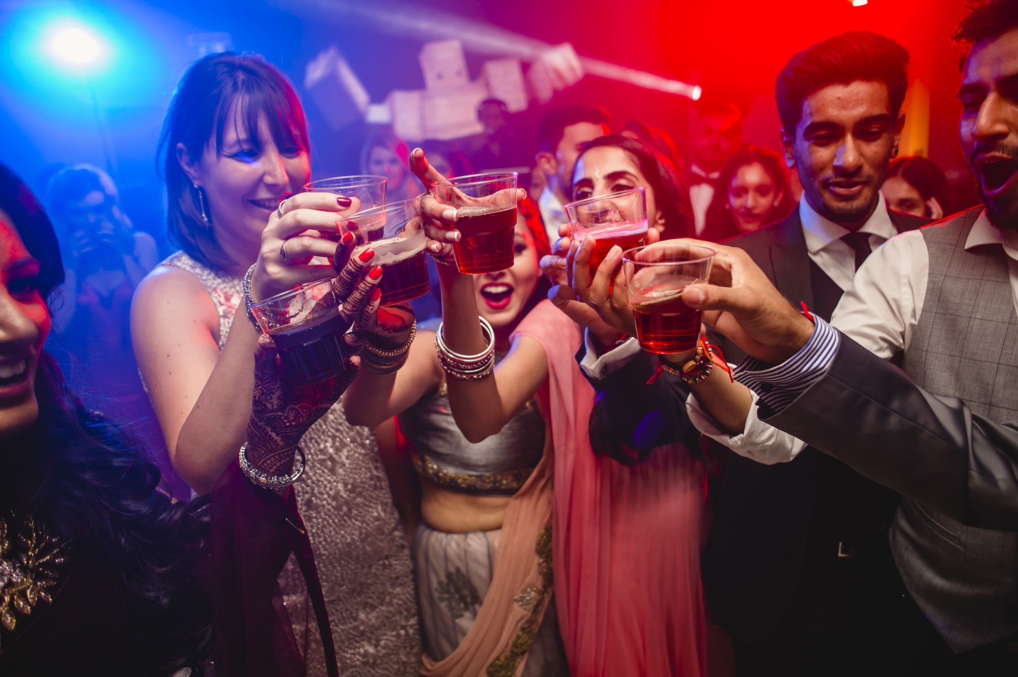 guests with shots during the wedding reception