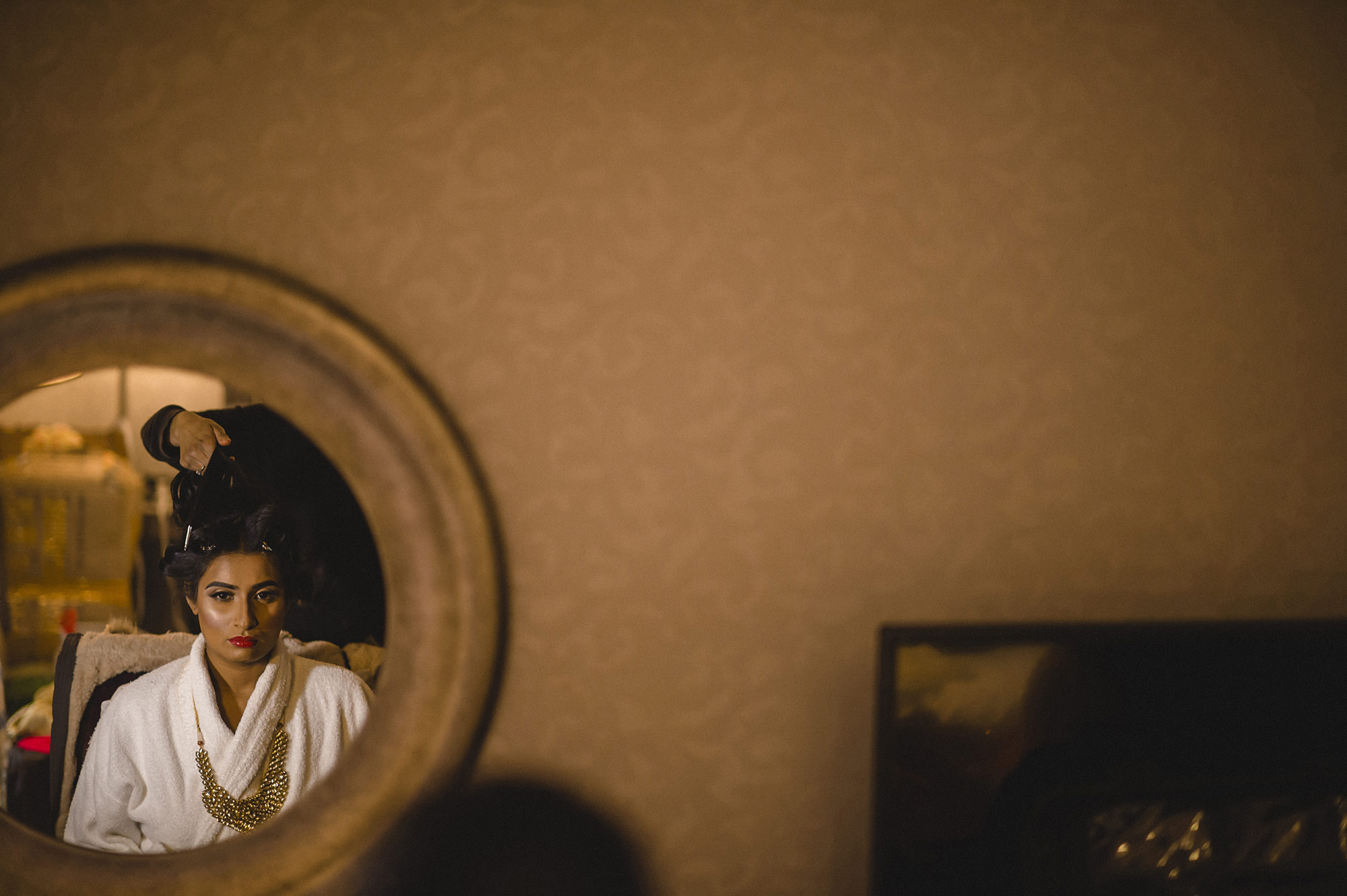 bride getting ready in the morning of her hindu wedding
